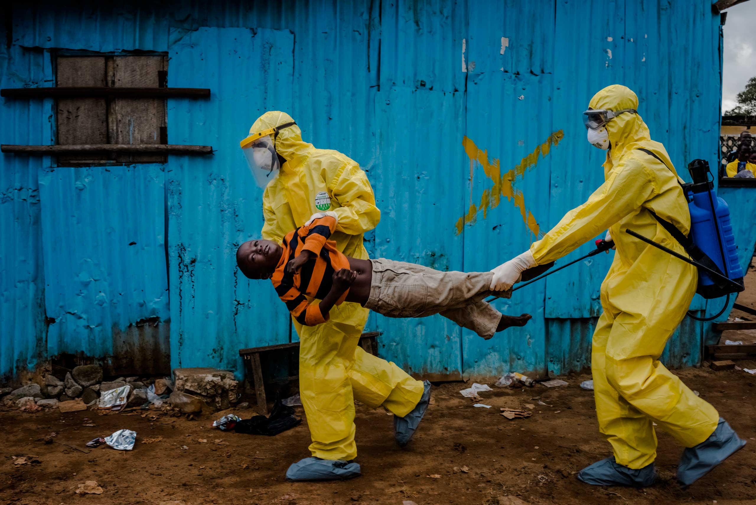 Picture of the Year Istanbul Photo AwardsJames Dorbor, 8, an Ebola victim, is rushed by medical staff wearing protective clothing into the JFK Ebola treatment center,  September 05, 2014 in Monrovia, Liberia.