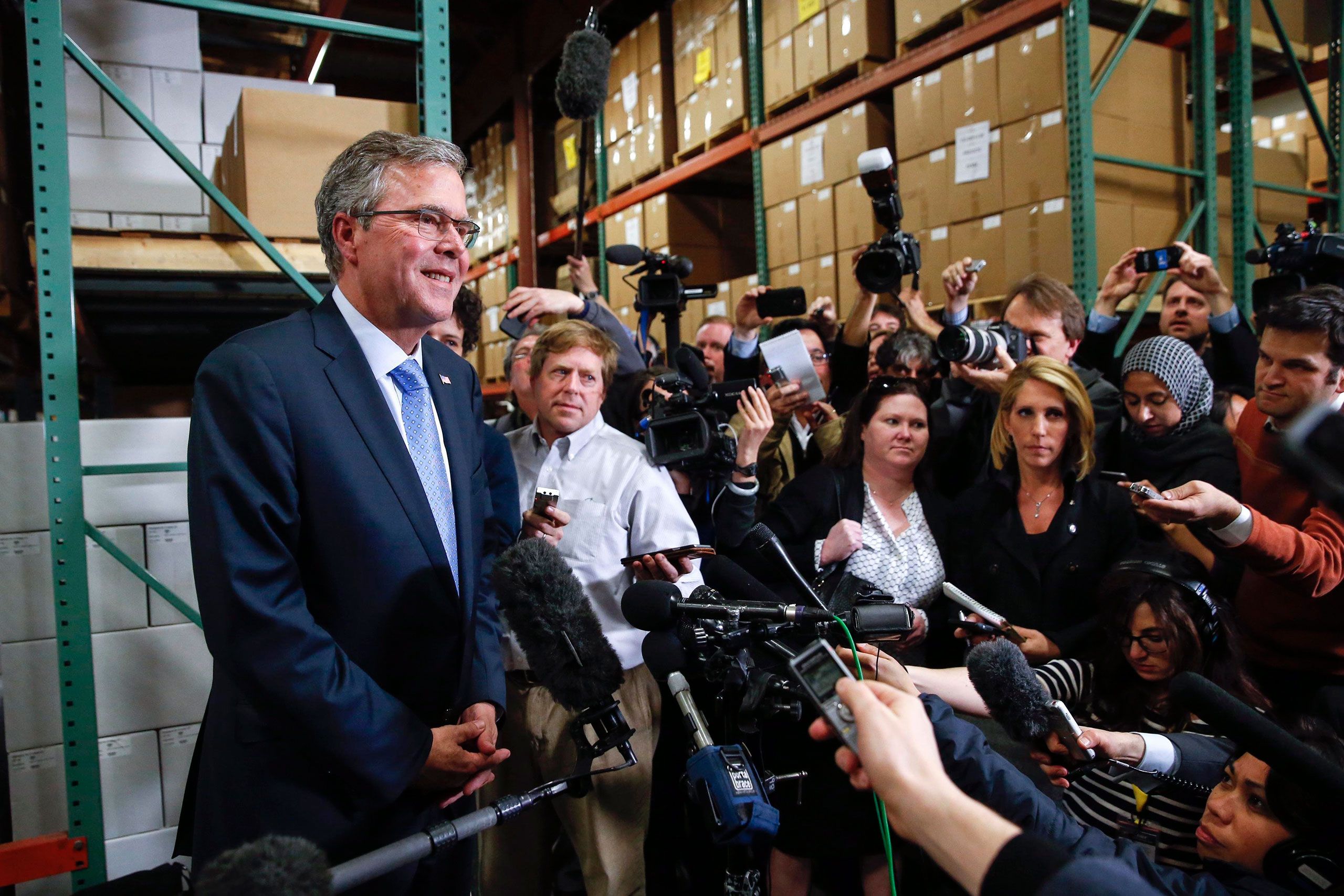 Former Florida Governor Jeb Bush speaks to the media after visiting Integra Biosciences during a campaign stop in Hudson, New Hampshire March 13, 2015.