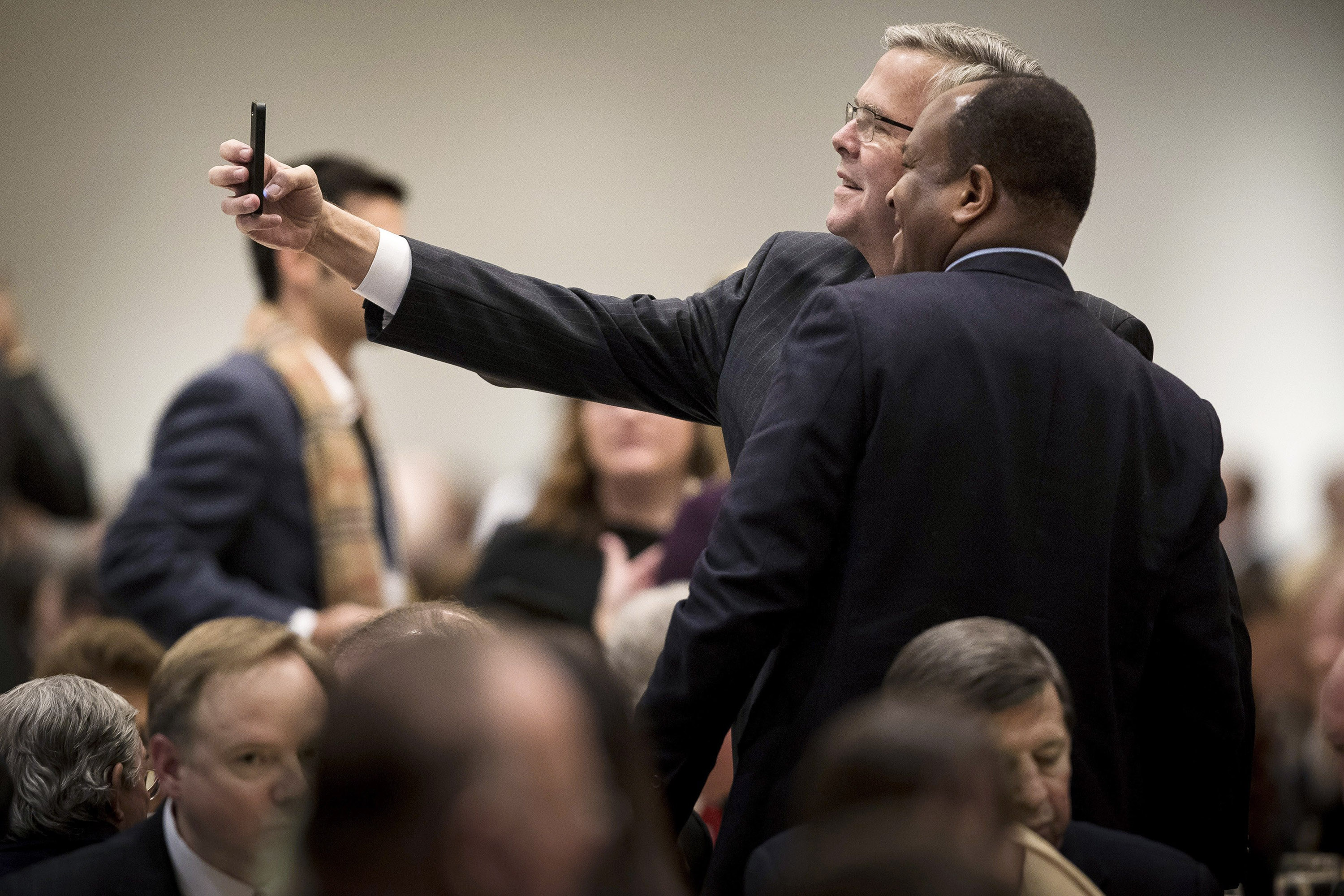 Jeb Bush with a fan at the Chicago Council on Global Affairs in February.