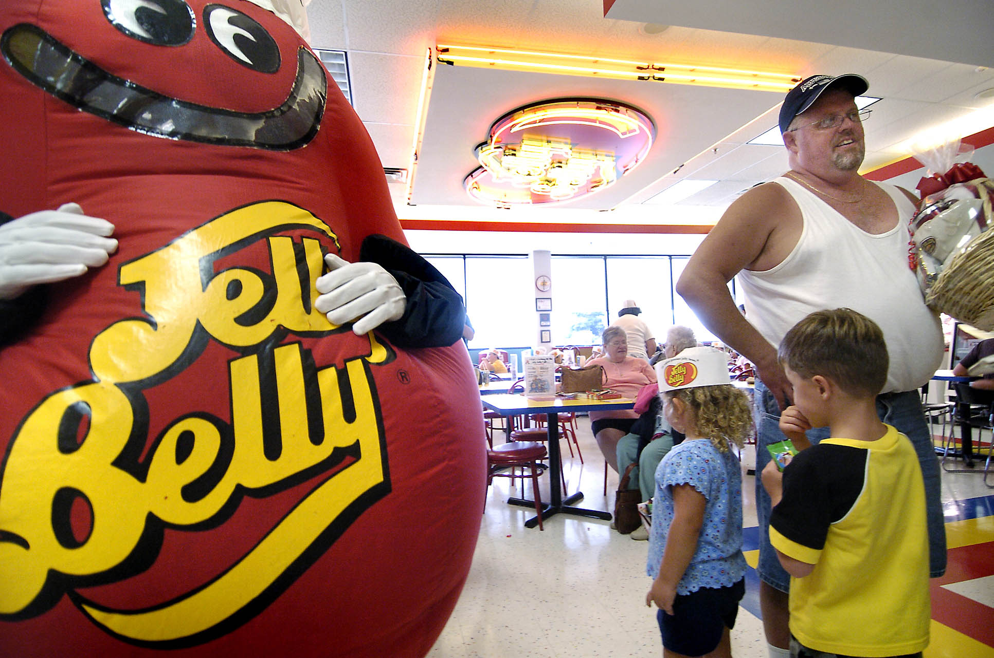 Michael Lively of Hammond, Ind., stands near the Mr. Jelly Belly mascot at the Jelly Belly Center in Pleasant Prairie, Wis on July 26, 2006.