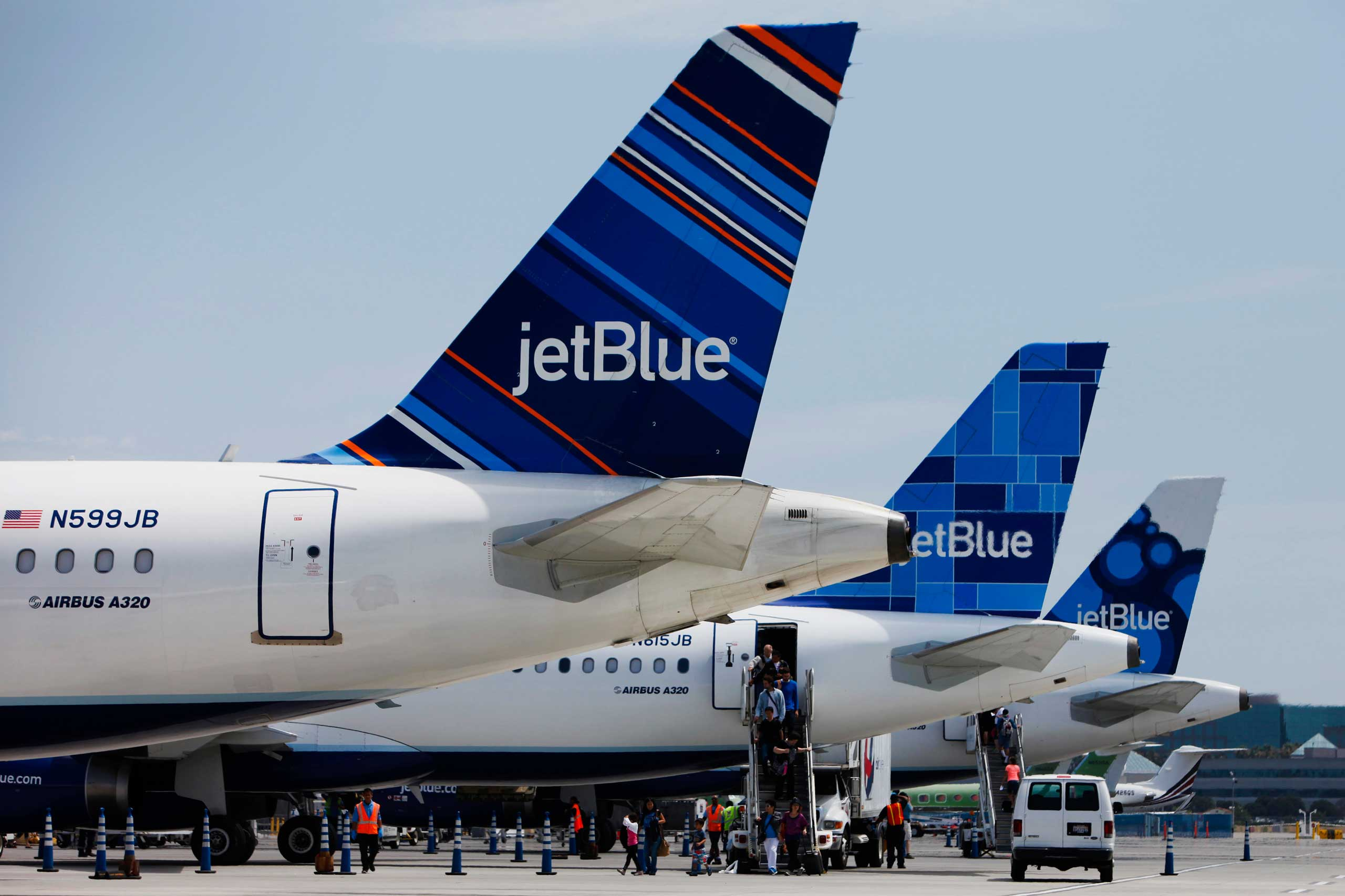 Passengers exit a JetBlue Airways Corp. plane at Long Beach Airport (LGB) in Long Beach, California, U.S., on Monday, July 22, 2013.