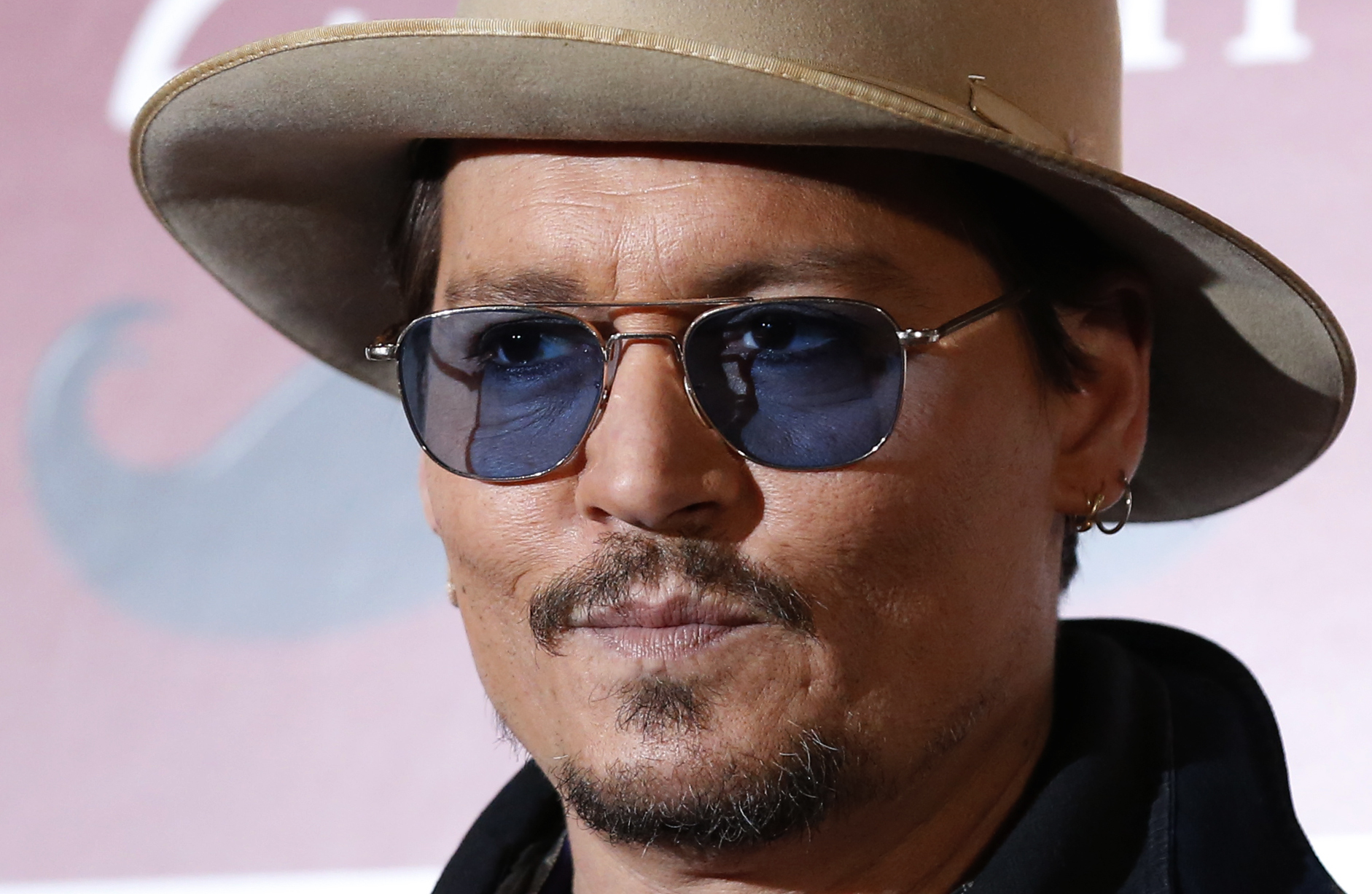 Actor Johnny Depp poses during a photo session ahead of a news conference for his movie Mortdecai in Tokyo on Jan. 28, 2015
