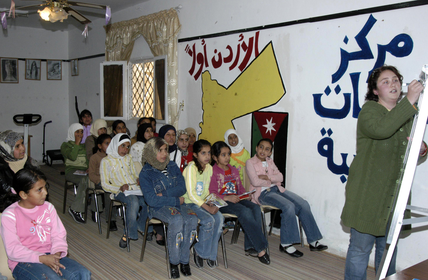 This Nov. 16, 2006 photo provided by the Peace Corps, shows Andrea Girard from Coulterville, CA., teaching English at an all girls school in Jordan.