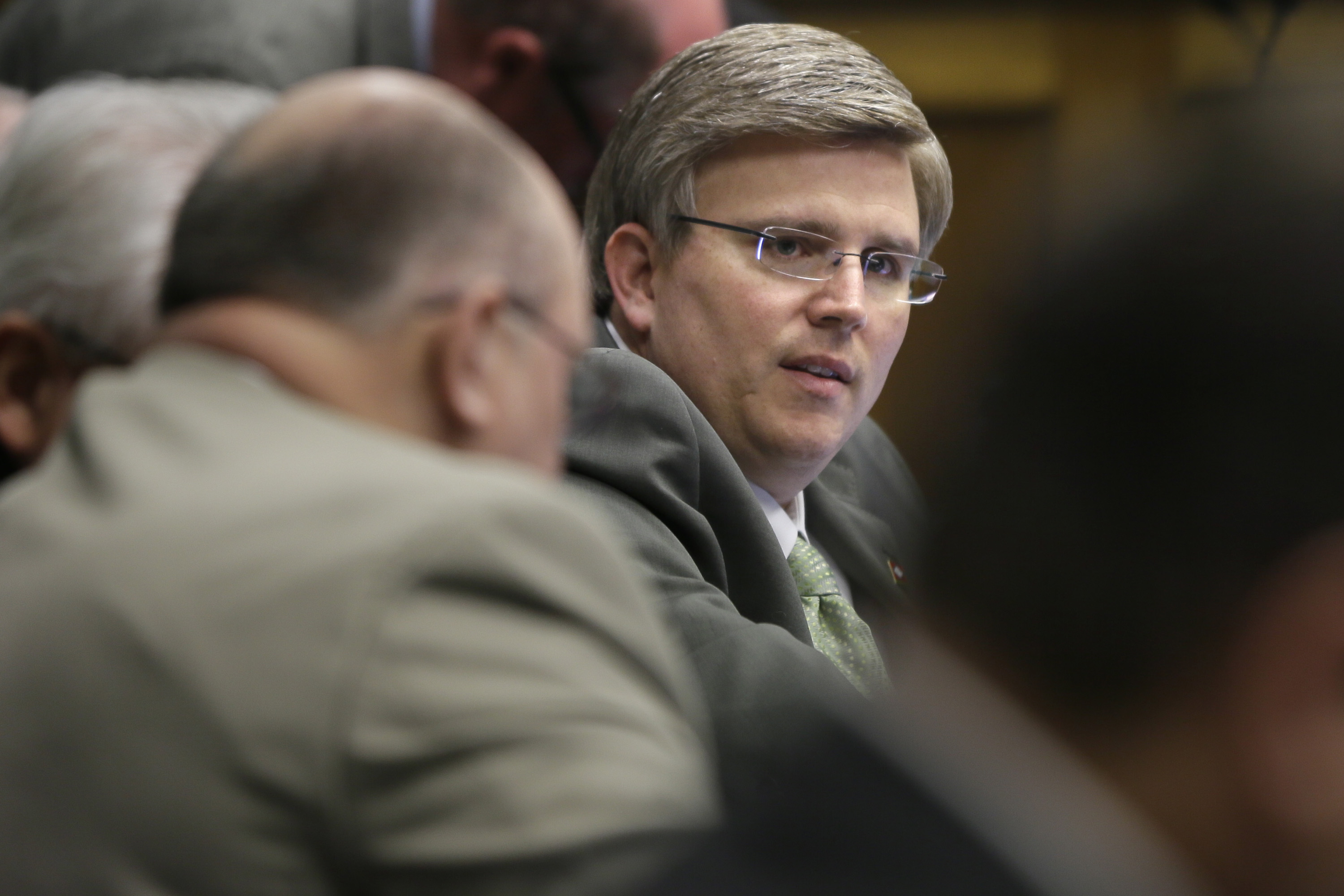 Rep. Justin T. Harris, R-West Fork, questions a witness during a meeting of the House Committee on Education at the Arkansas state Capitol in Little Rock, Ark. on Feb. 26, 2015.