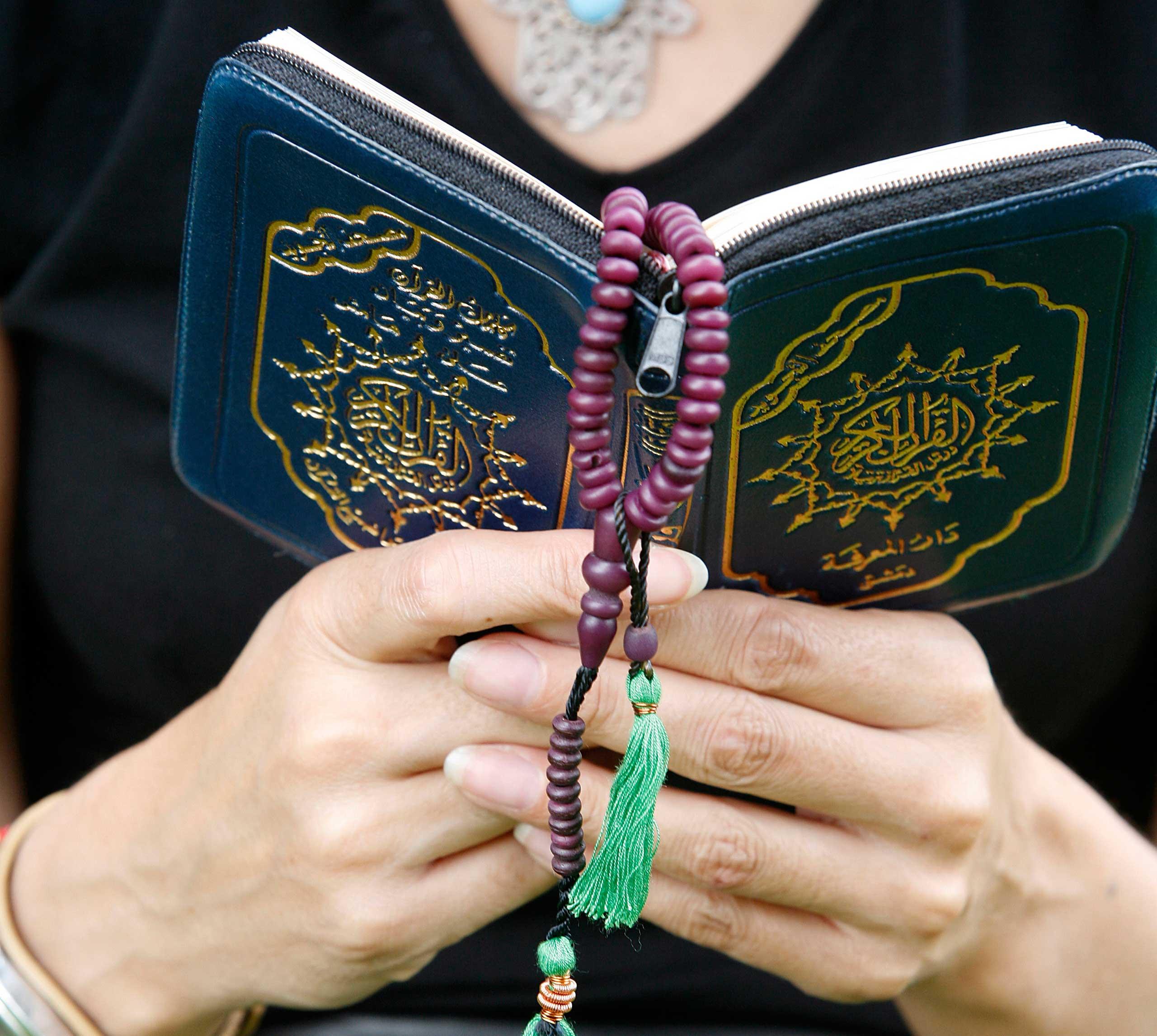 Woman reading the Koran.