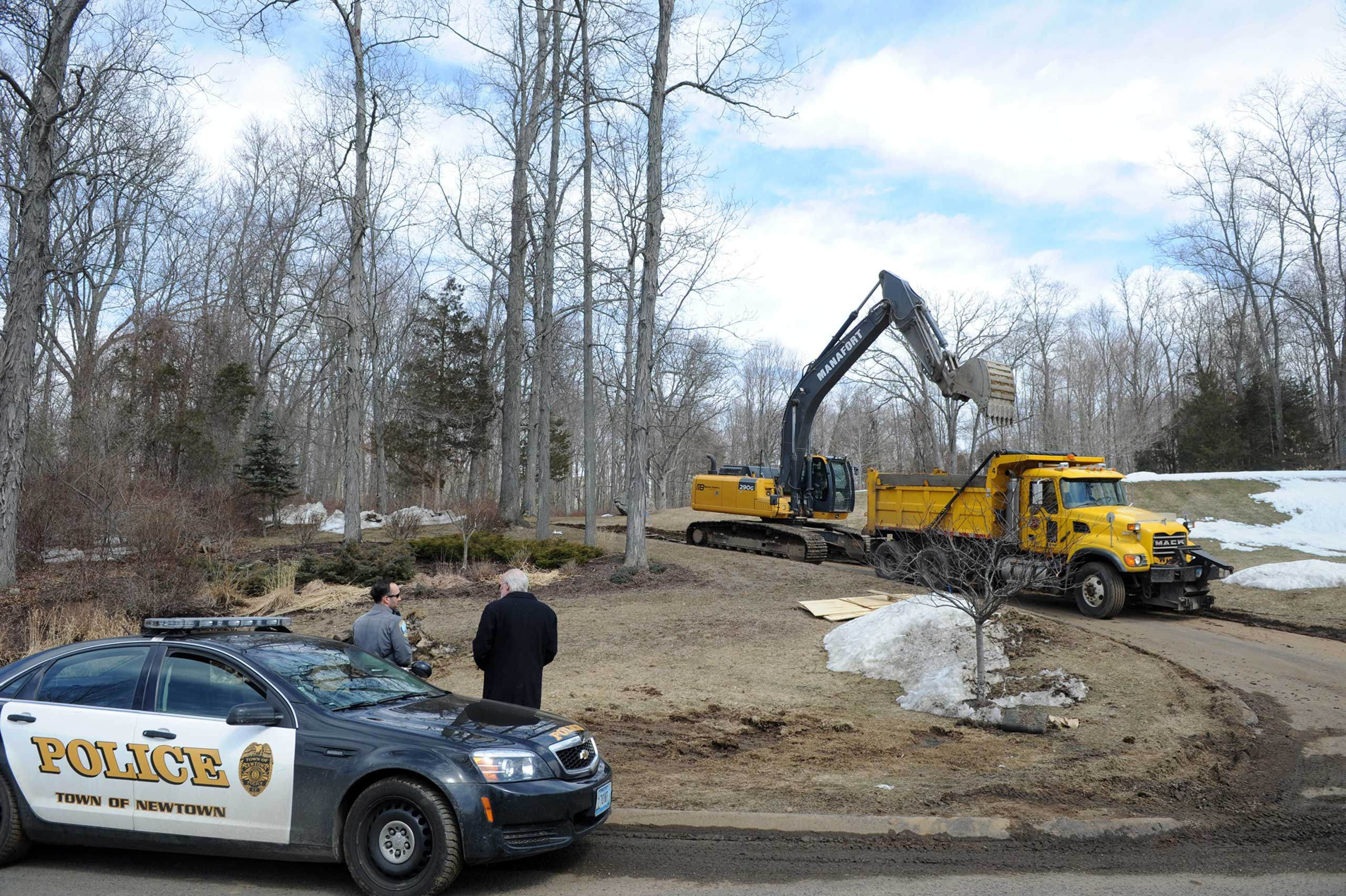 A crew finishes up the demolition, March 24, 2015, of the home of Nancy Lanza, where she had lived with her son Adam Lanza in Newtown, Conn.