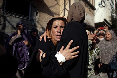 Women mourn during the funeral of boys who were killed by an Israeli naval bombardment in the port of Gaza, July 16, 2014.