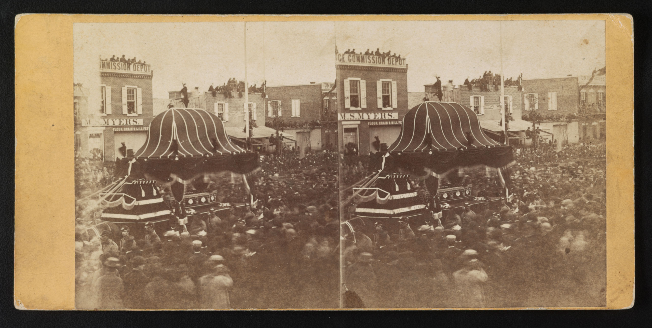 Abraham Lincoln's casket conveyed by funeral car through the crowd on Broad Street in Philadelphia, April 22, 1865.