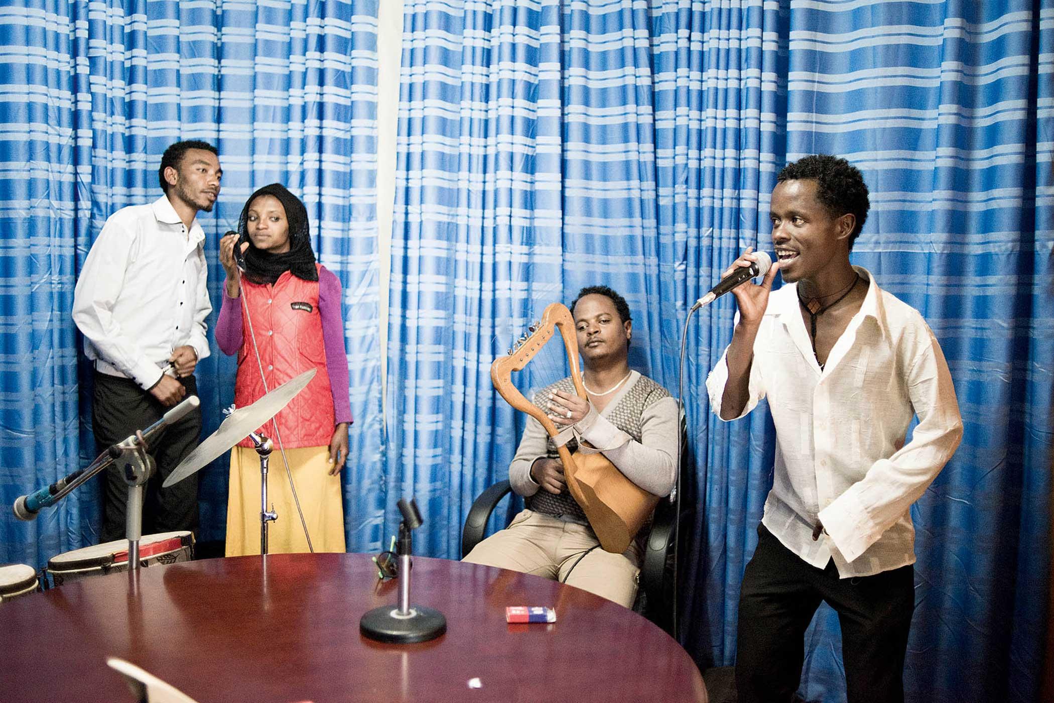 Circus Debere Berhan Circus members recording music at a local radio station.