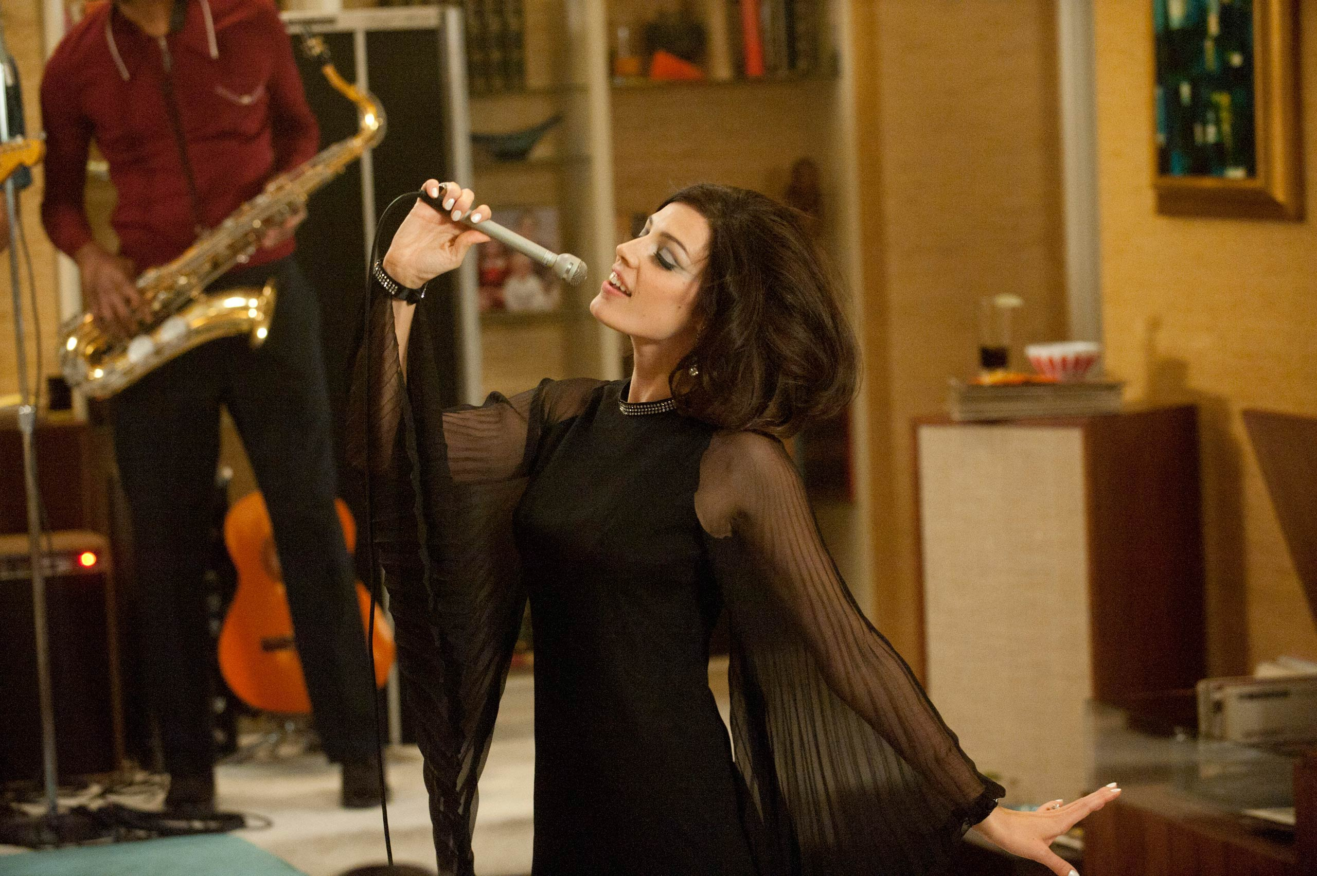 <strong>Megan's Zou Bisou Bisou dress</strong>                                    Megan surprises Don and her party guests with a performance as sultry as her little black dress.