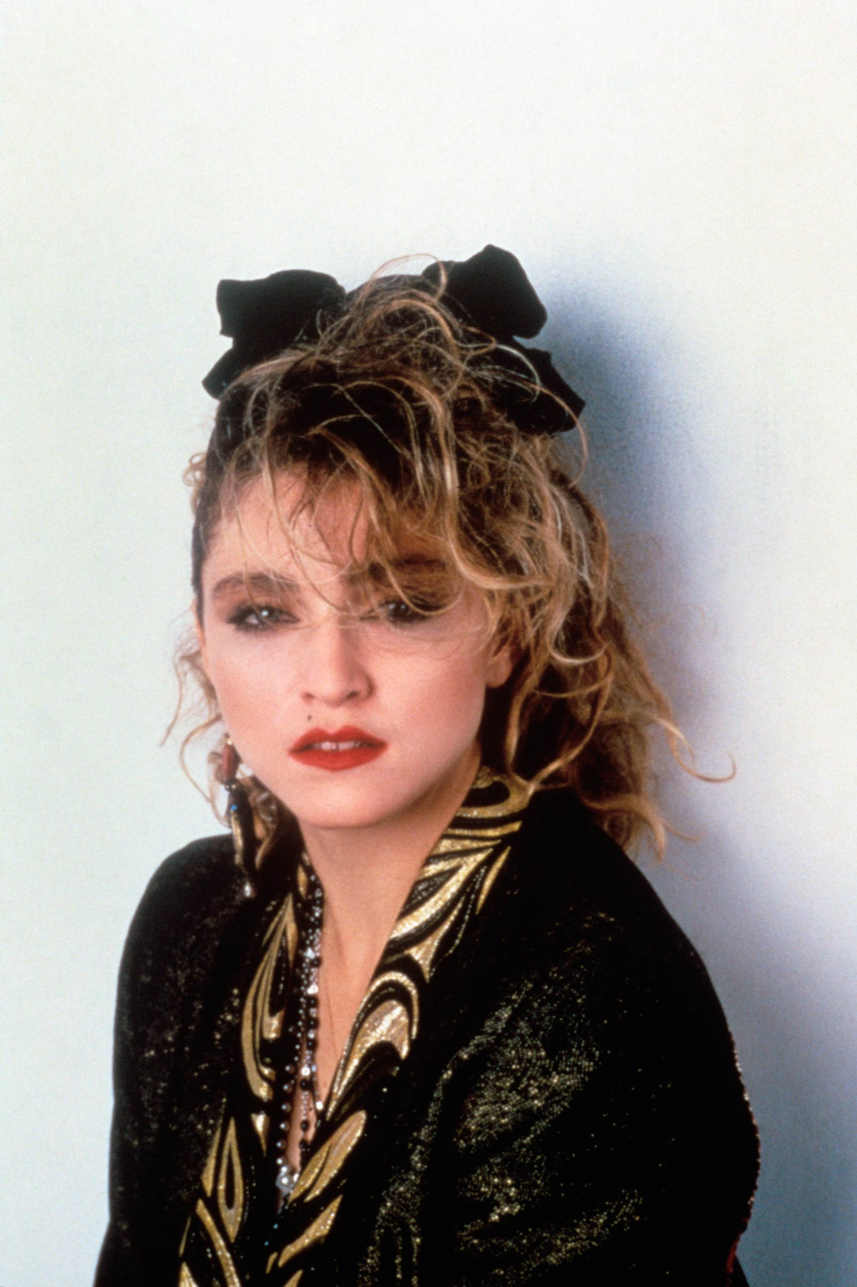 Madonna poses on the set of <i>Desperately Seeking Susan</i> in 1985.