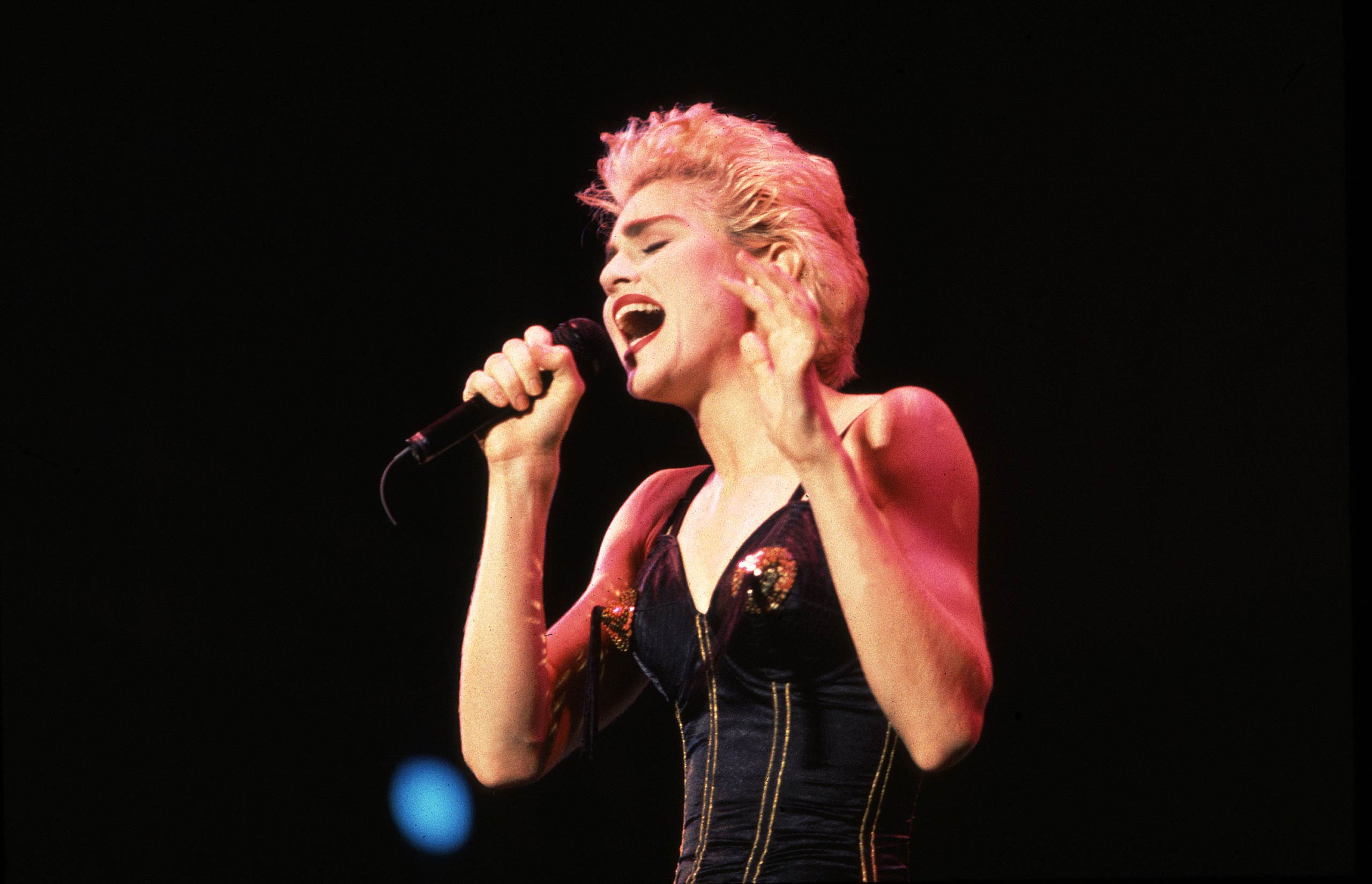 Madonna performs in Chicago in 1987.