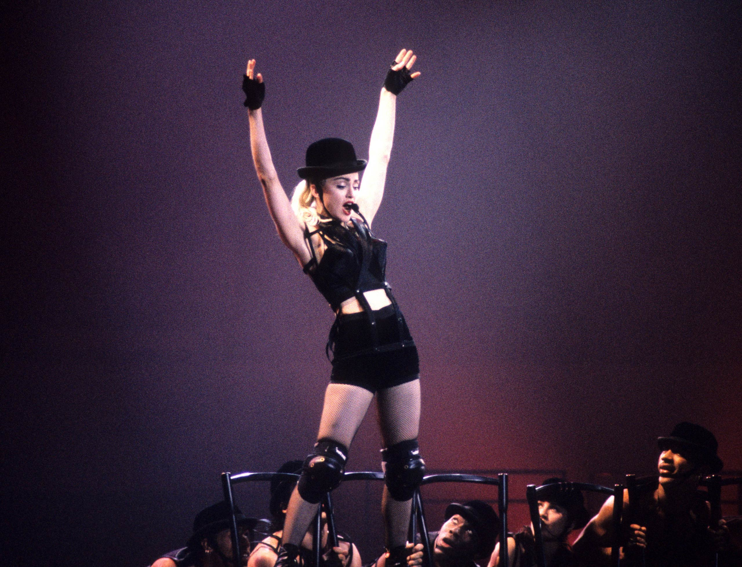 Madonna performs in concert in 1990.