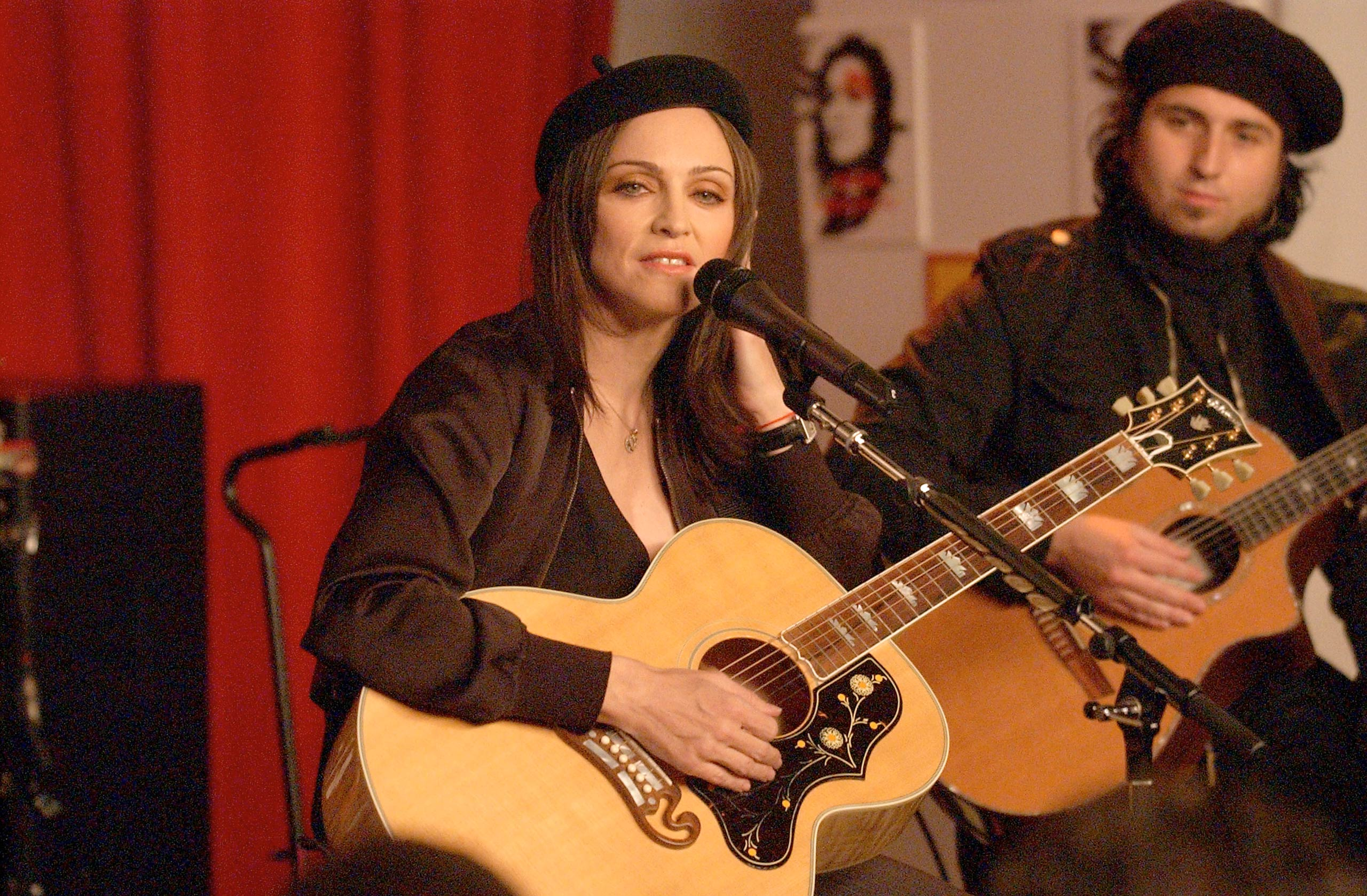 "Madonna performs songs from her new album ""American Life"" at Tower Records in New York City in 2003."