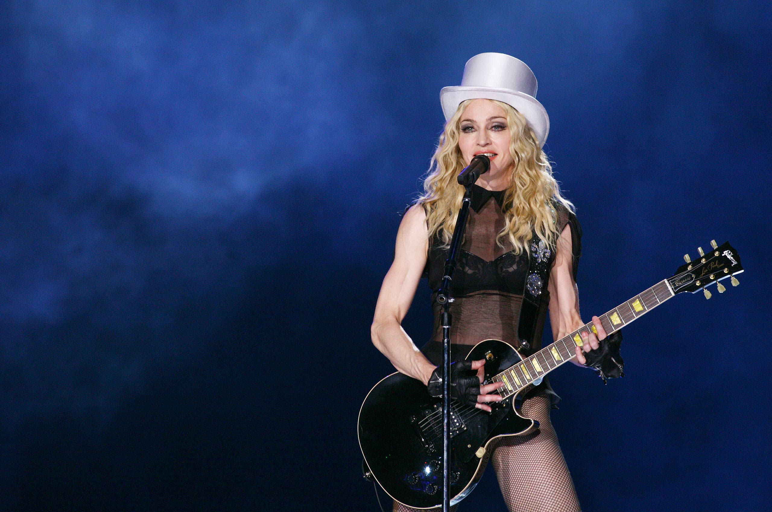 Madonna performs at Olympic Stadium during a concert of the 'Sticky and Sweet' world tour in Rome, Italy in 2008.