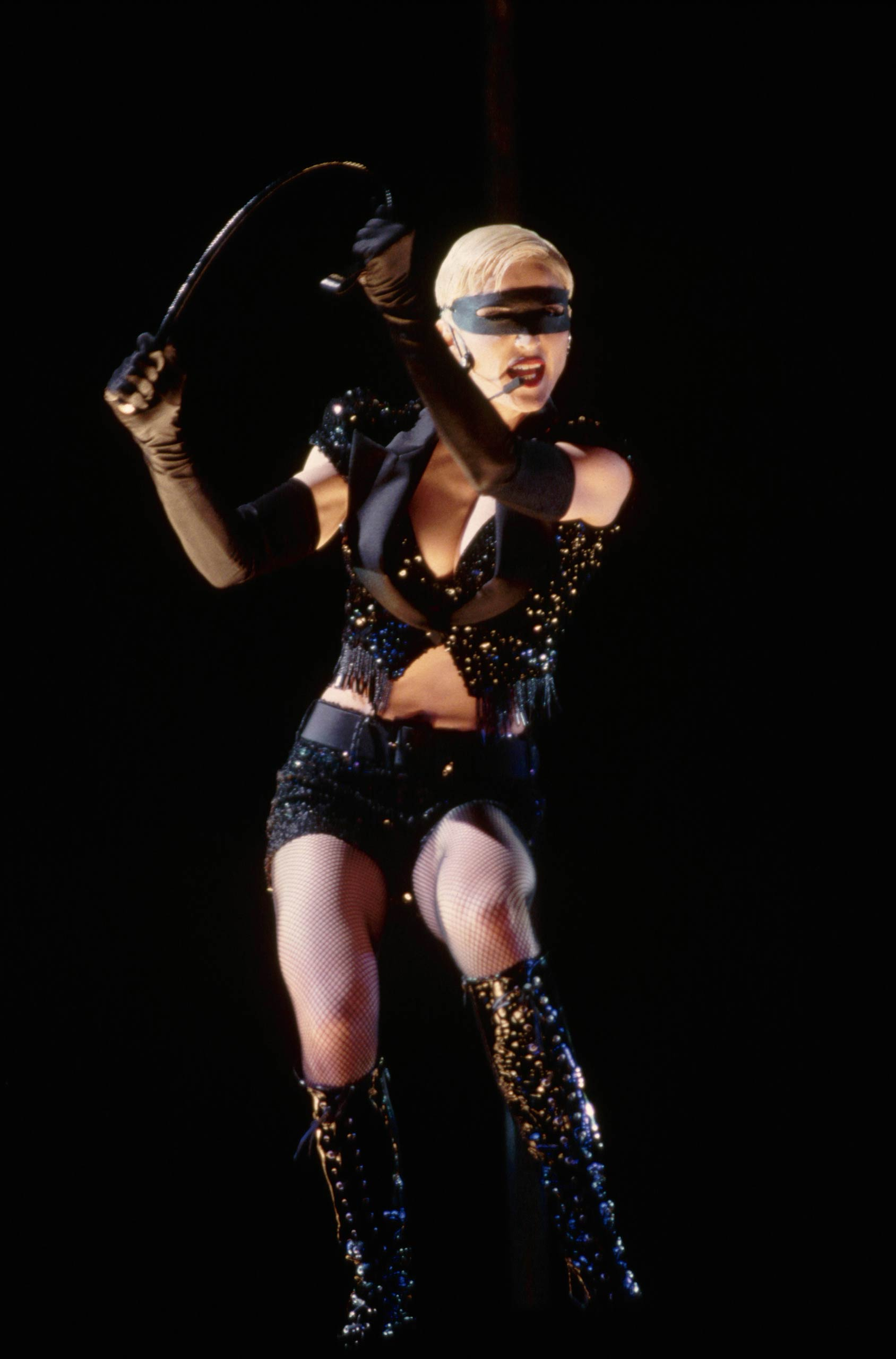 "Madonna performs during her ""Girlie Show"" in London, England in 1993."
