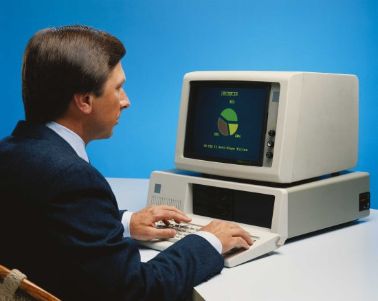 A stock photo of a man at a computer