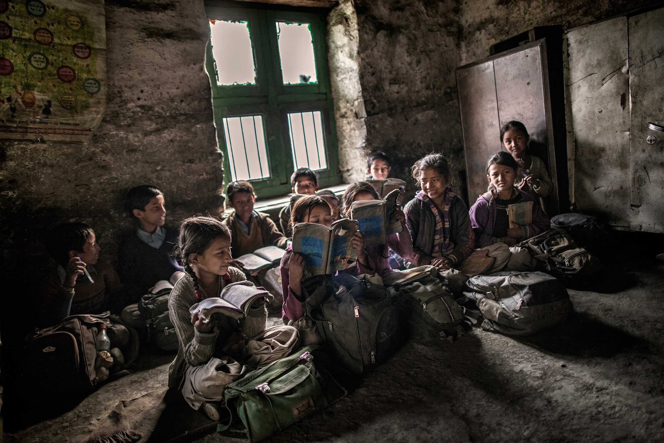 Young school children sit inside a classroom during a lesson in Dec. 2014.