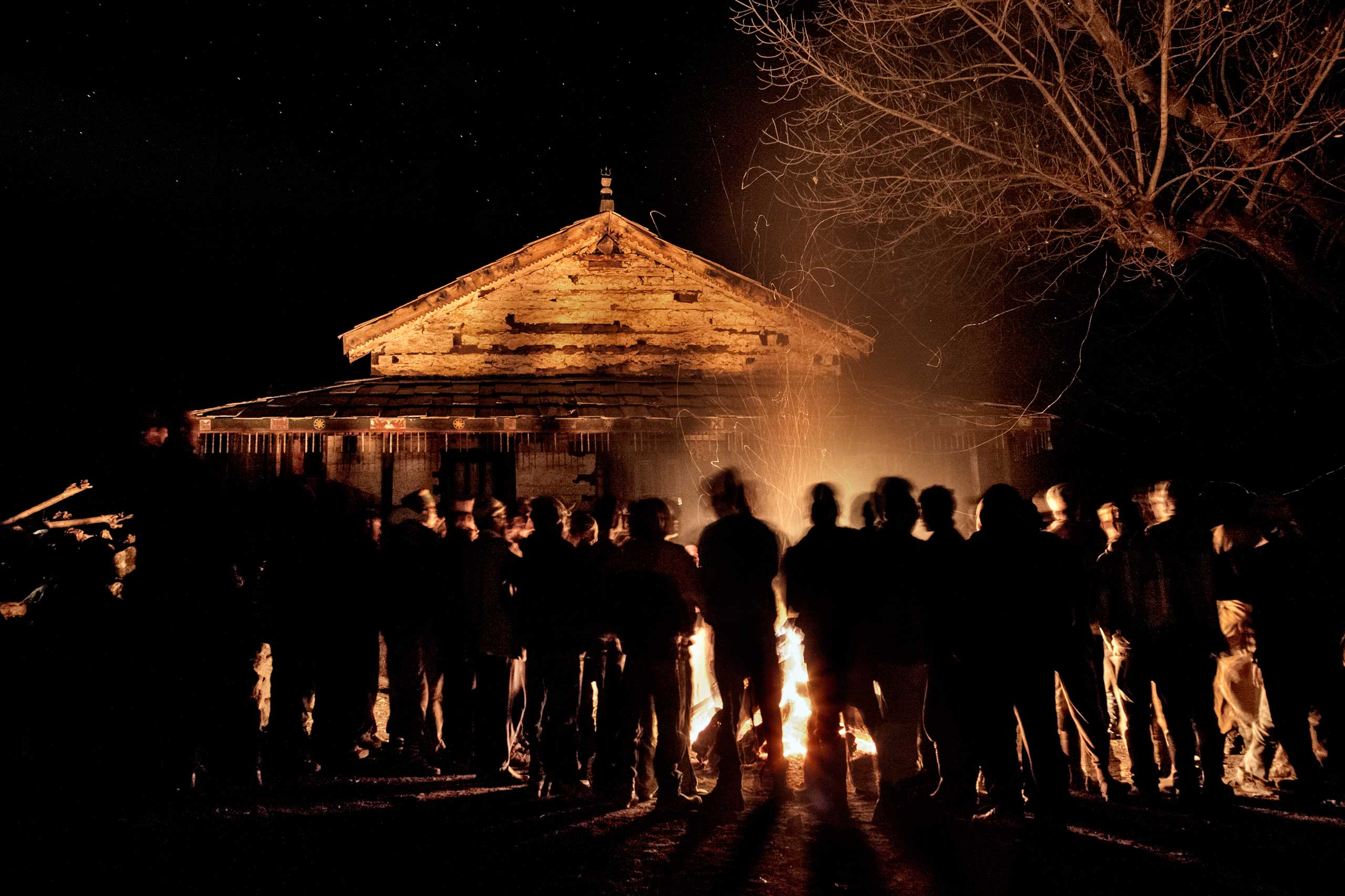 Villagers gather around a huge bonfire in front of a temple in the village in Dec. 2011.