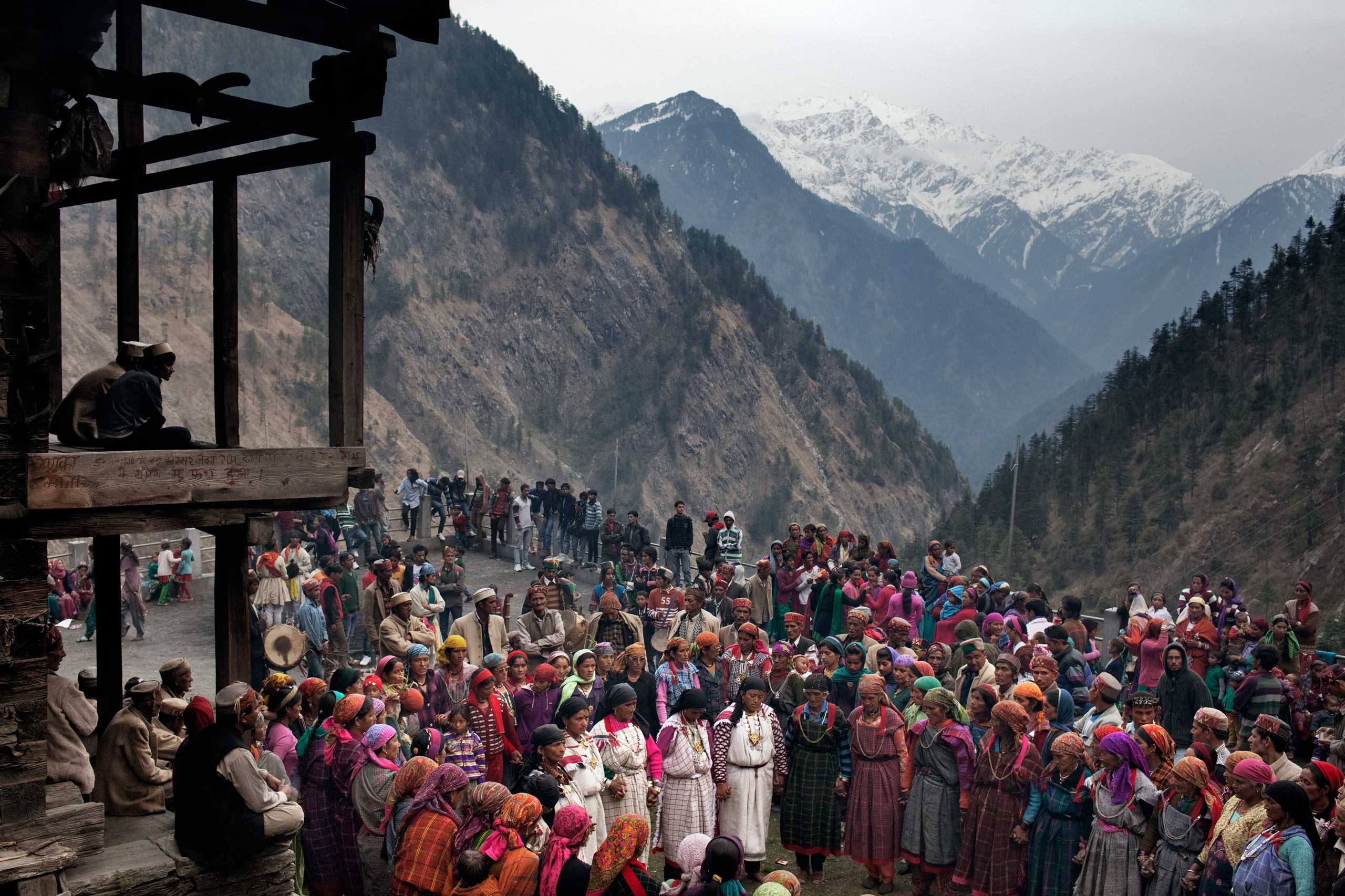 Villagers gather in the square during a celebration known as a 'mela' in which three different villages come together in April 2013.