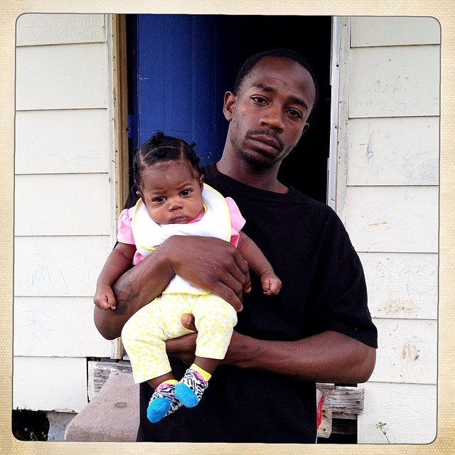 Portrait of Lil' Mike and his daughter in the Baptist Town neighborhood of Greenwood, Miss. on April 2, 2014.