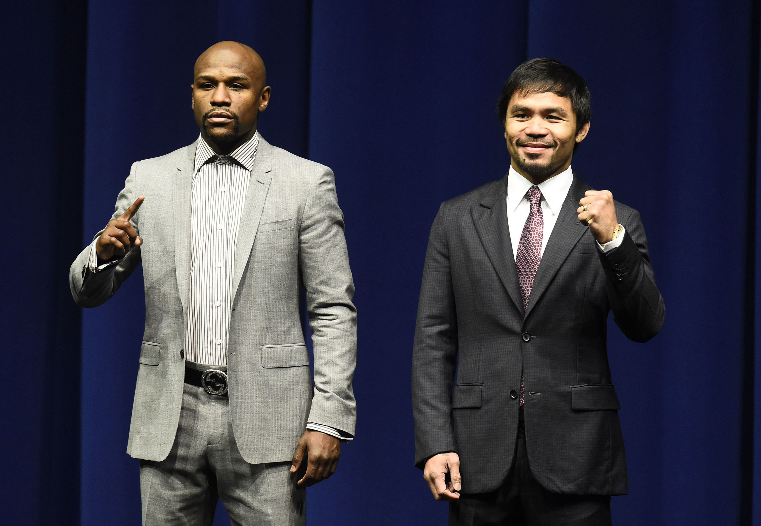 Boxers Floyd Mayweather Jr, left, and Manny Pacquiao gesture during a press conference on March 11, 2015 at the Nokia Theatre in Los Angeles.