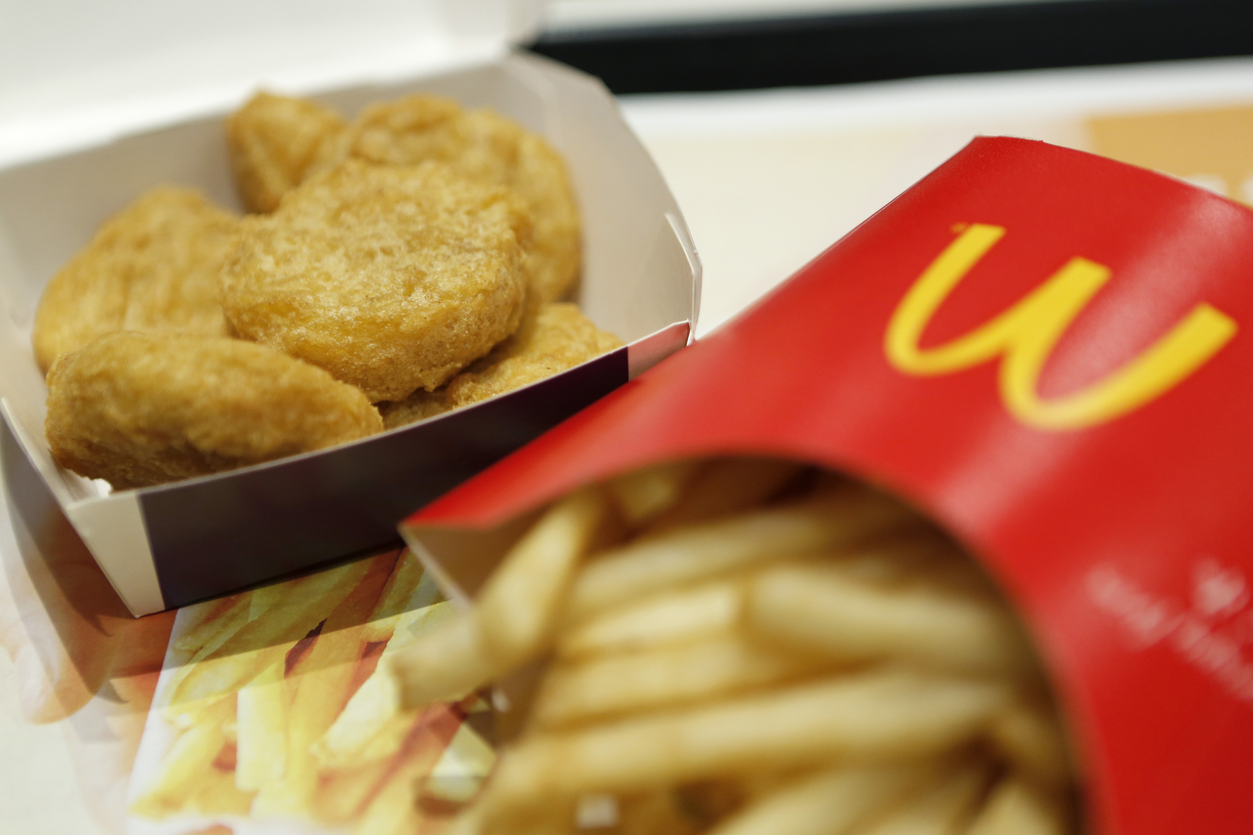 A box of chicken nuggets, left, sits beside a portion of french fries at a McDonald's restaurant, operated by McDonald's Holdings Co. Japan Ltd., in Tokyo, Japan, on Jan.7, 2015.