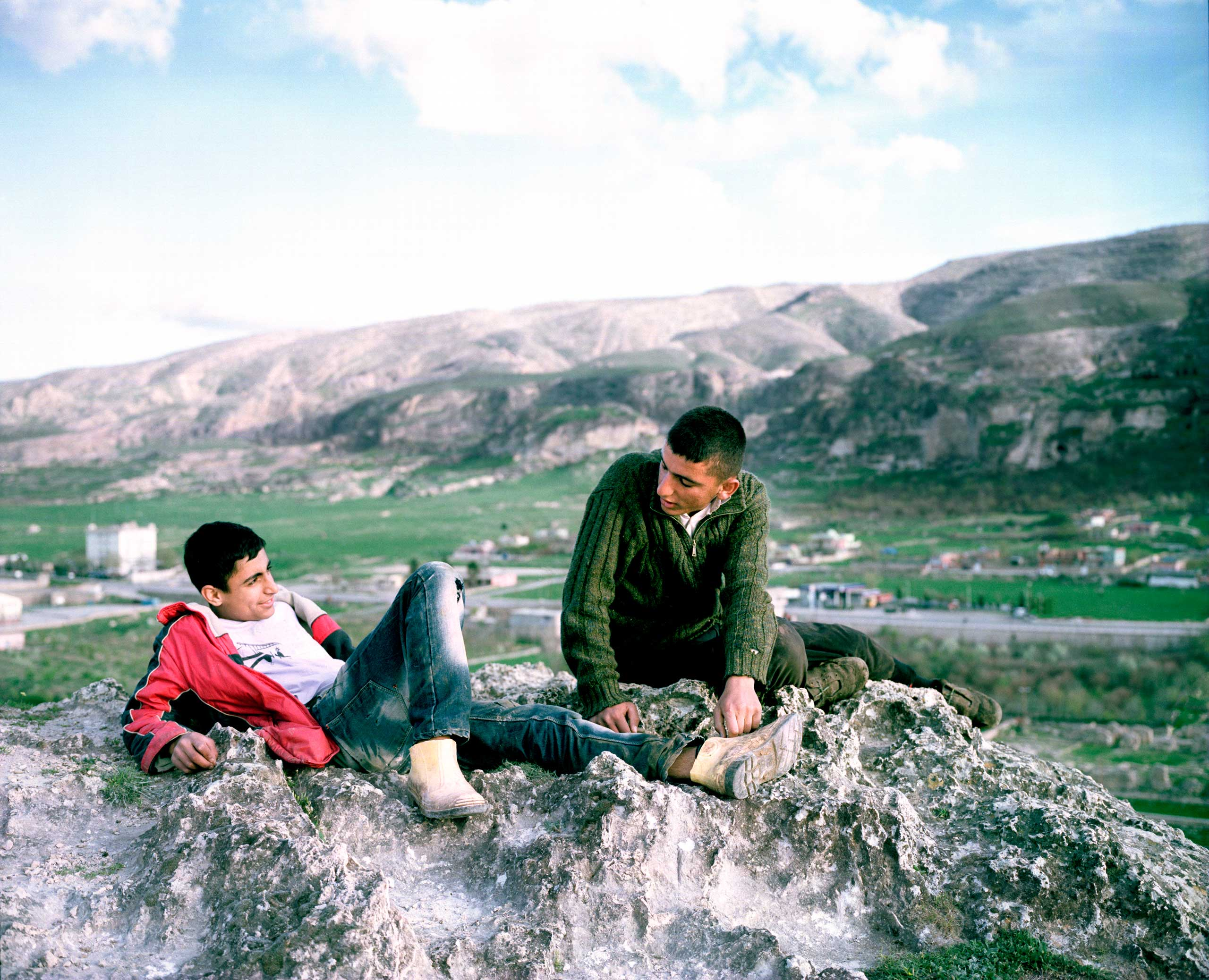 Boys stand on top of a hill dominating the banks of the Tigris River. Kesmeköprü, Turkey.