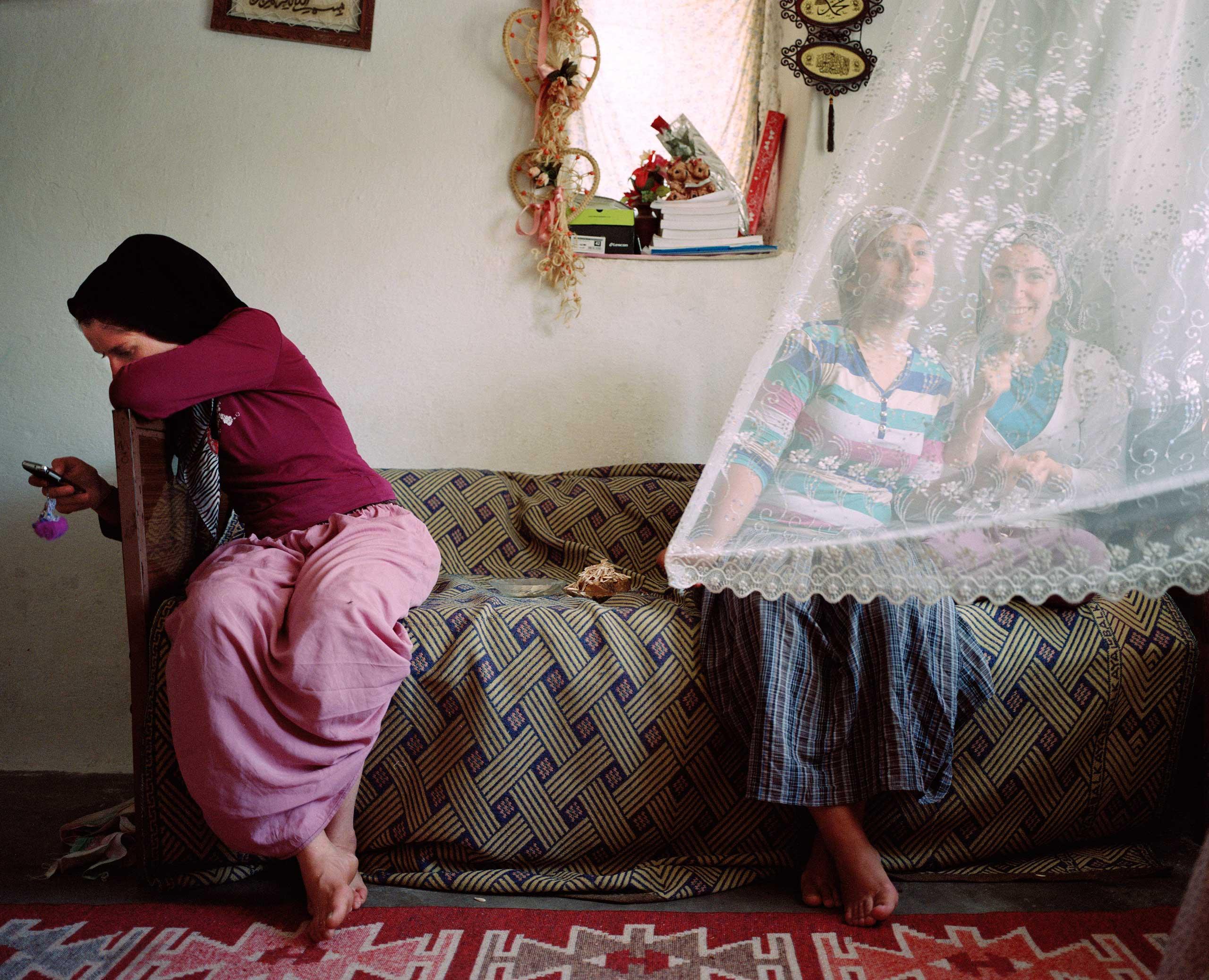 Local girls meet over a çay, or tea, together. Hasankeyf, Turkey.