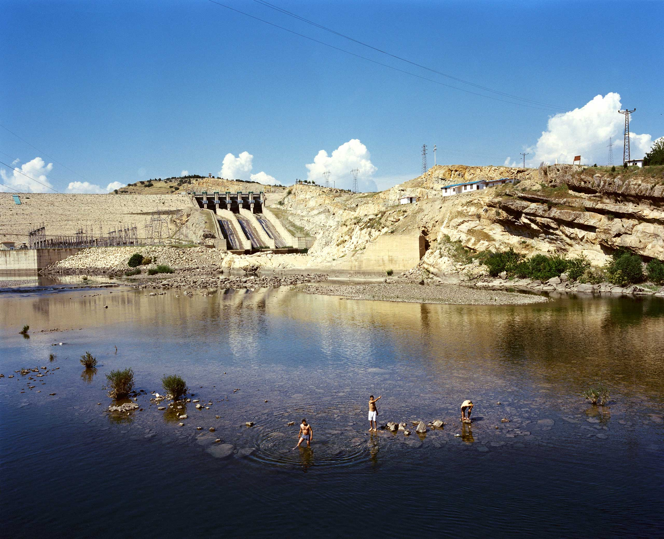 Men are swimming in the waters of the Batman Dam. Batman, Turkey.