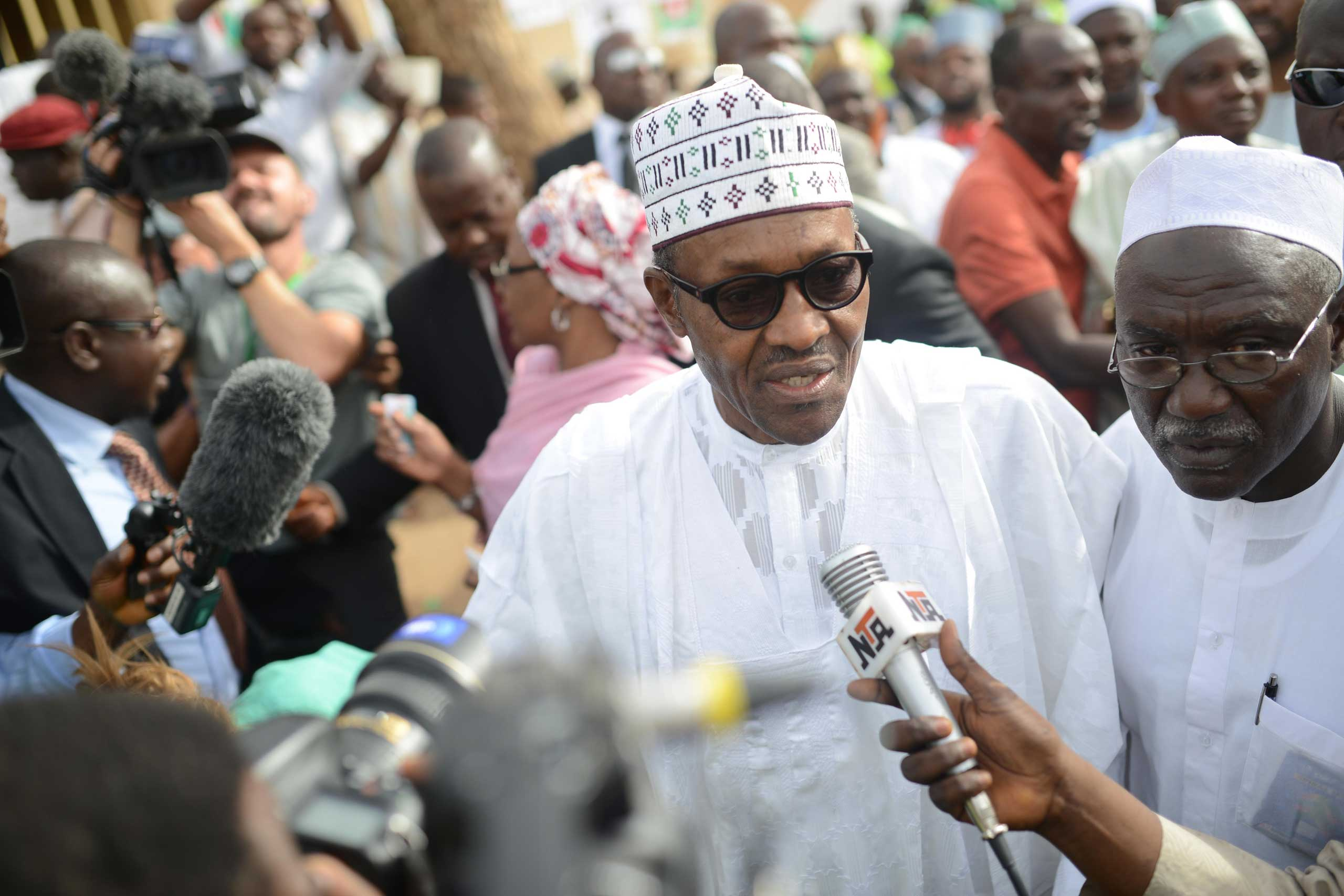 Mohammadu Buhari, the presidential candidate of the main opposition party All Progressives Congress, speaks to the press as he arrives for registration at Gidan Niyam Sakin Yara polling station in Daura district of Katsina, Nigeria, on March 28, 2015