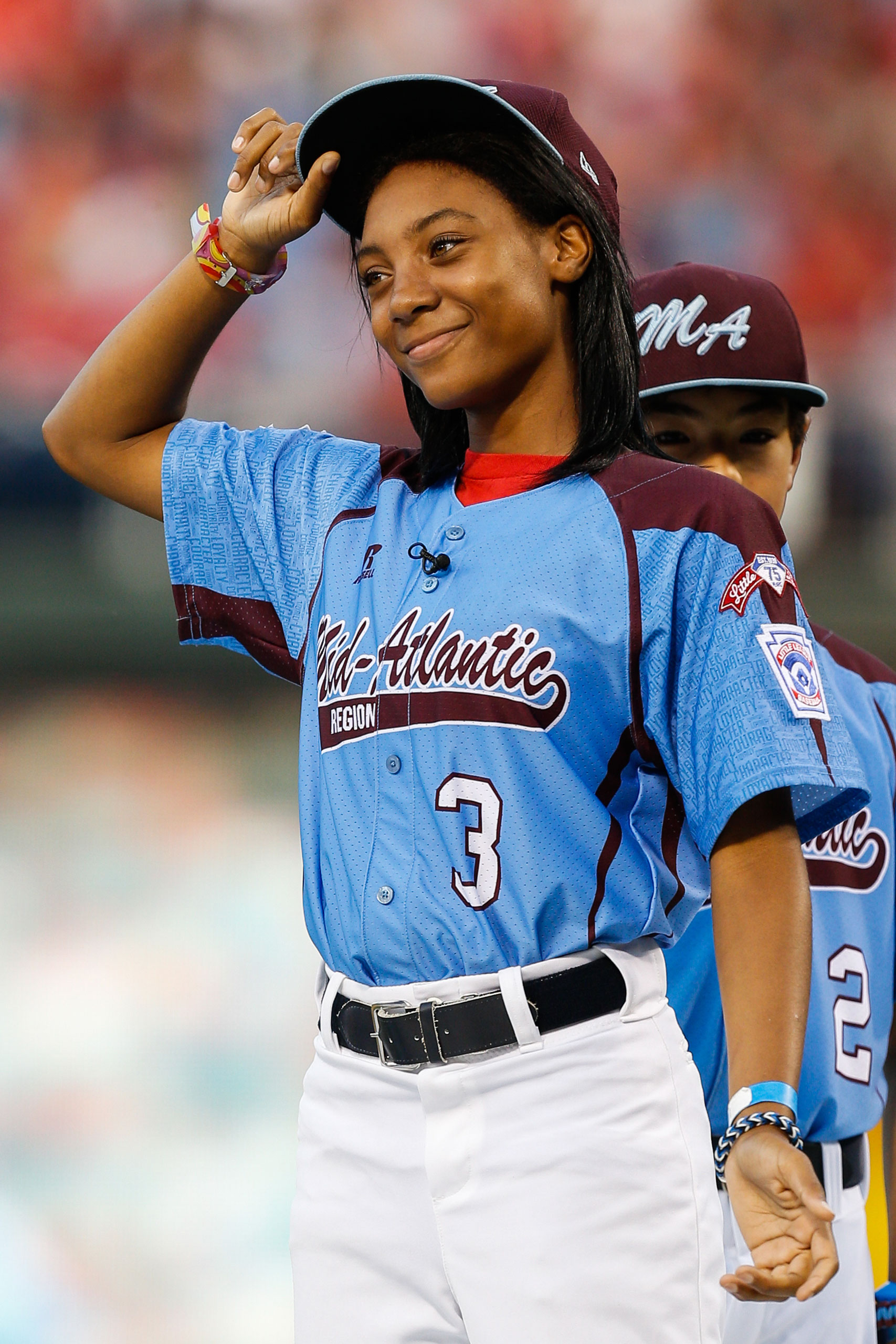 Taney Dragons Pitcher Mo'ne Davis tips her hat as she is introduced and recognized before the game between the Washington Nationals and the Philadelphia Phillies at Citizens Bank Park on Aug. 27, 2014 in Philadelphia