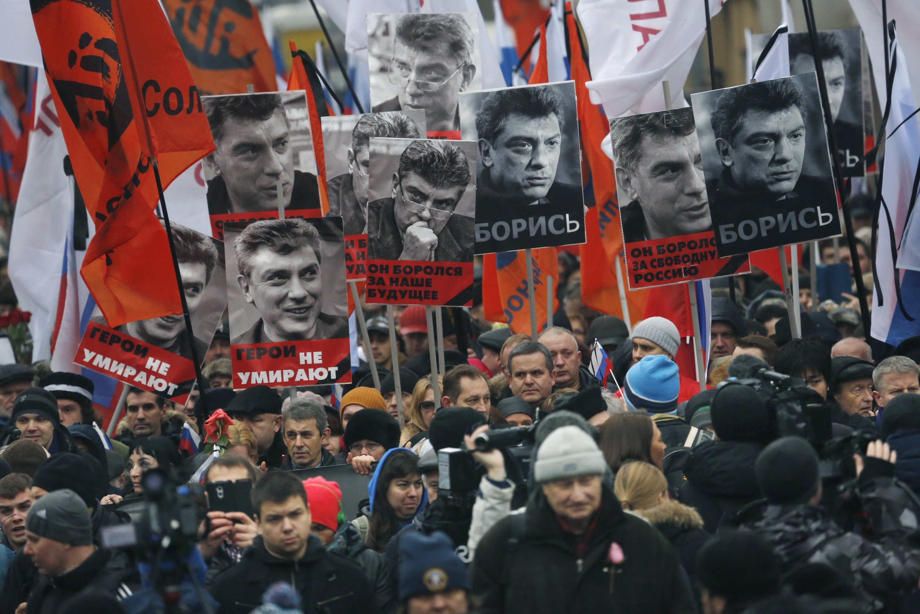 People march in memory of opposition leader Boris Nemtsov near the Kremlin in Moscow on March 1, 2015.