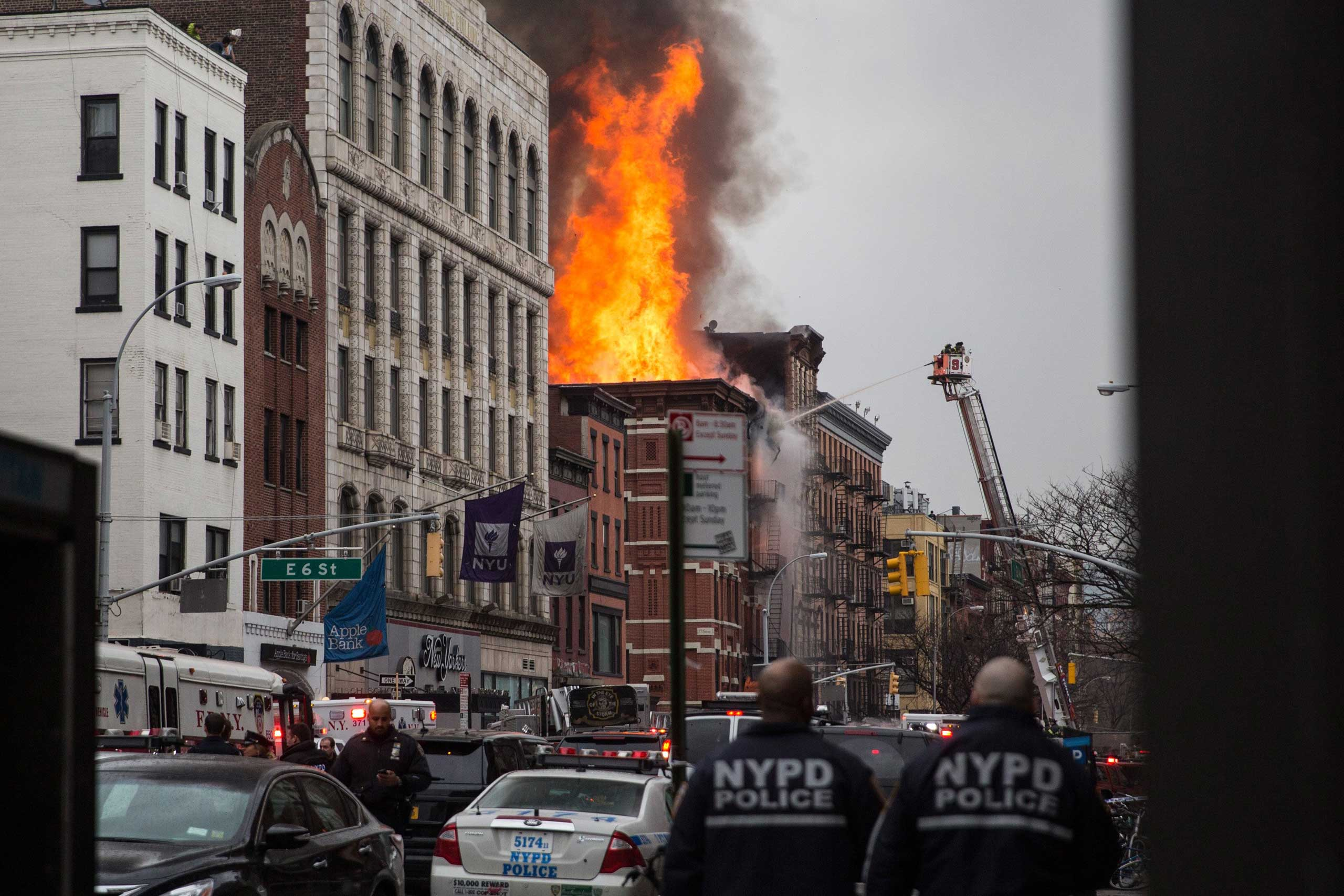 A building on 2nd Avenue burns after a collapse in the East Village section of New York City on March 26, 2015.