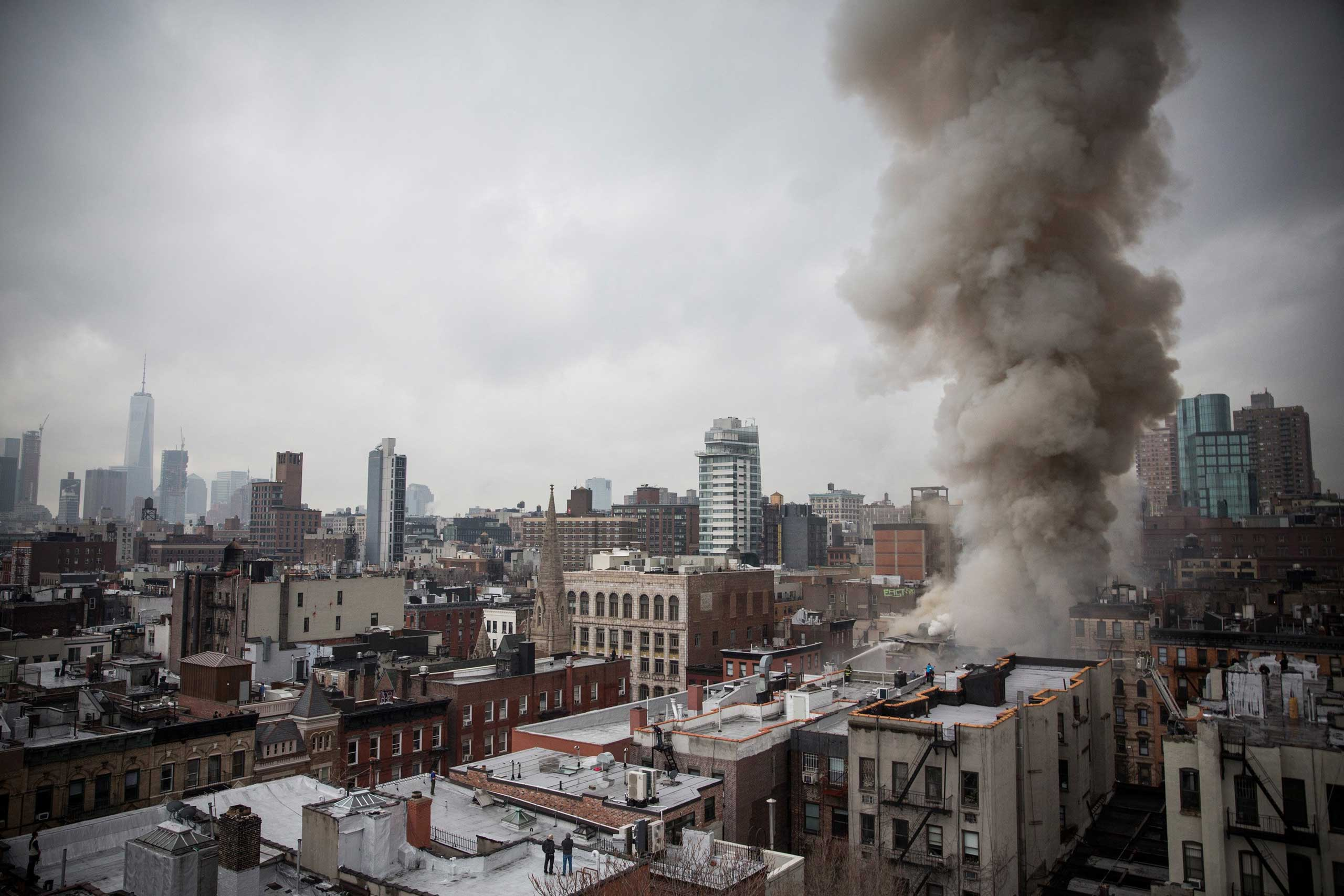 Smoke rises from a burning building after a collapse on 2nd Avenue in the East Village section of New York City on March 26, 2015.