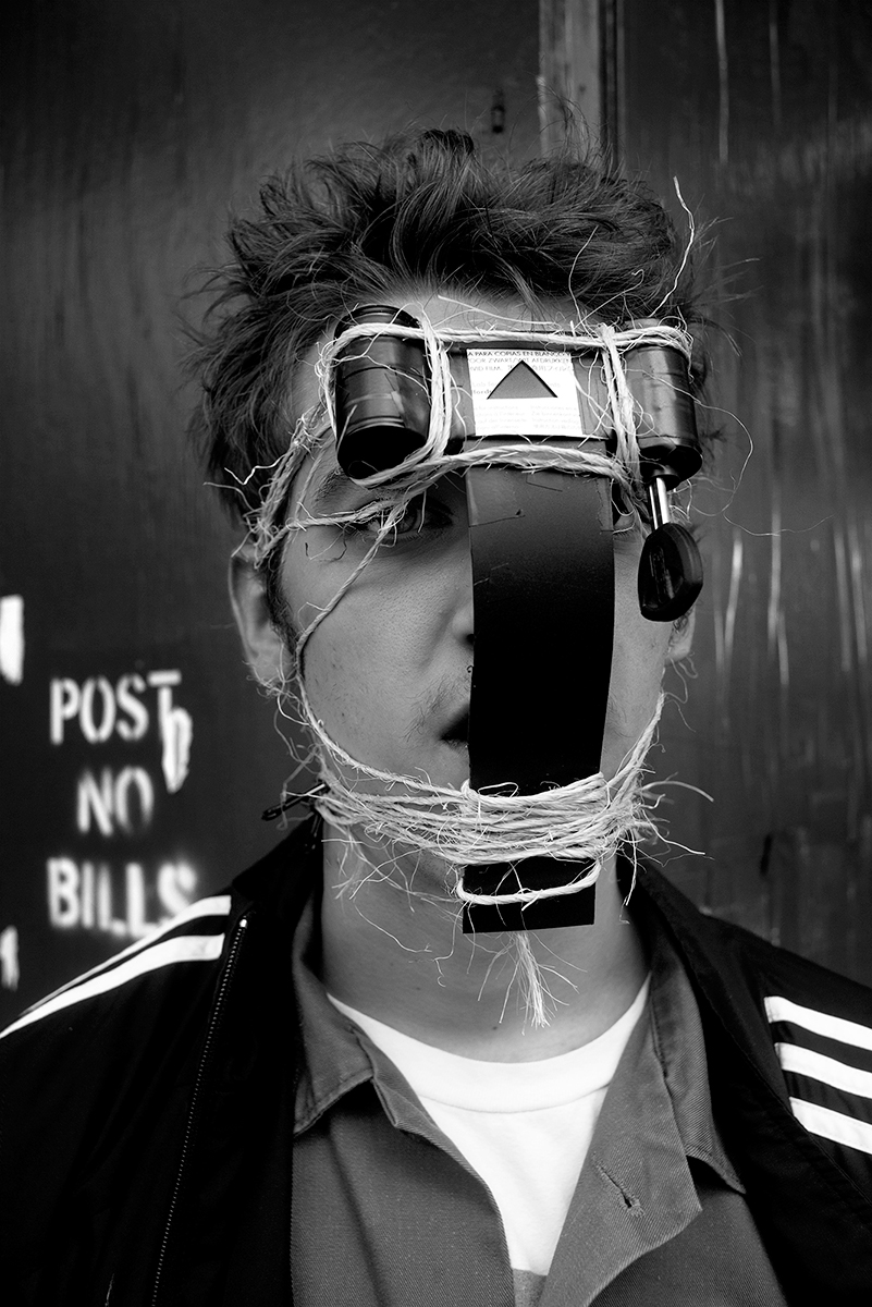 A portrait of Nicholas WIlliams wearing the jaw-operated pinhole camera in New York CIty in June 2014.