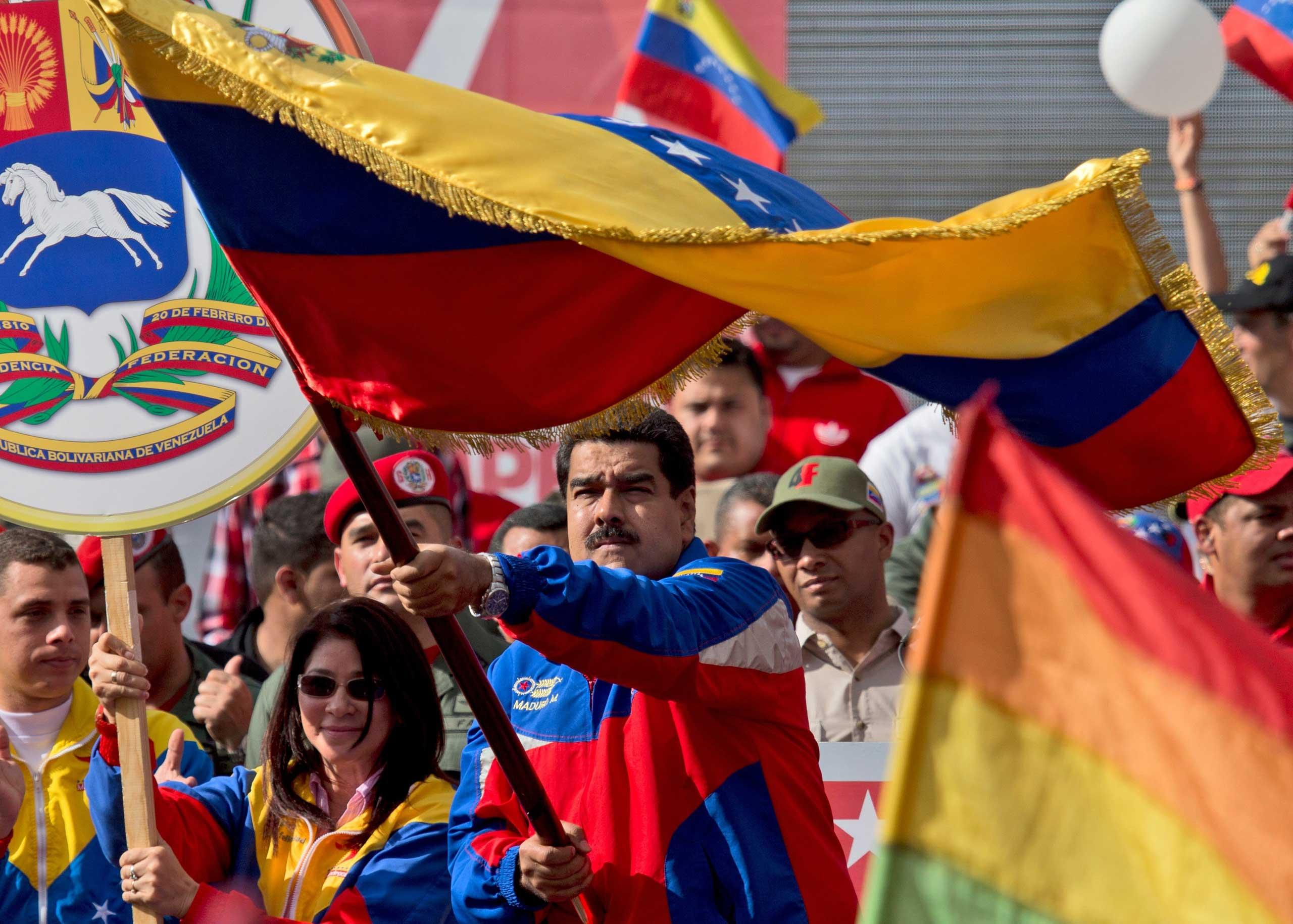 Venezuela's President Nicolas Maduro, center, in Caracas, Venezuela, on Feb. 28, 2015.