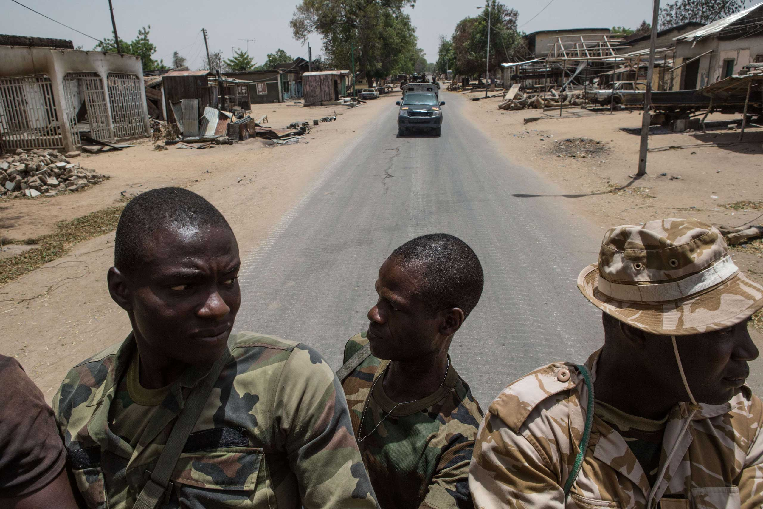 Nigerian troops patrol in Bama, in the country's northeast on March 25, 2015.
