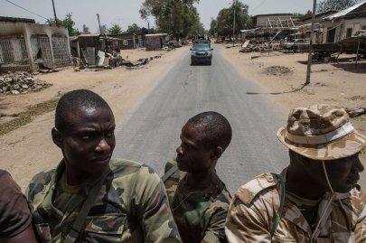 Nigerian troops patrol in Bama on March 25, 2015.
