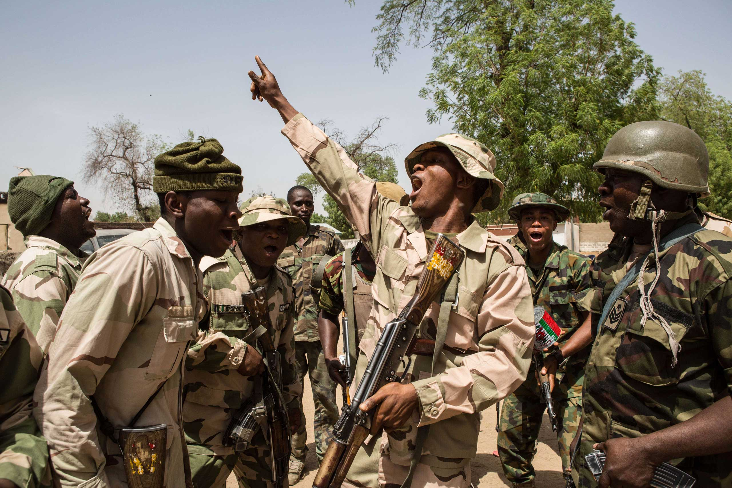 Nigerian troops celebrate after taking over Bama from Boko Haram about a week earlier on March 25, 2015.