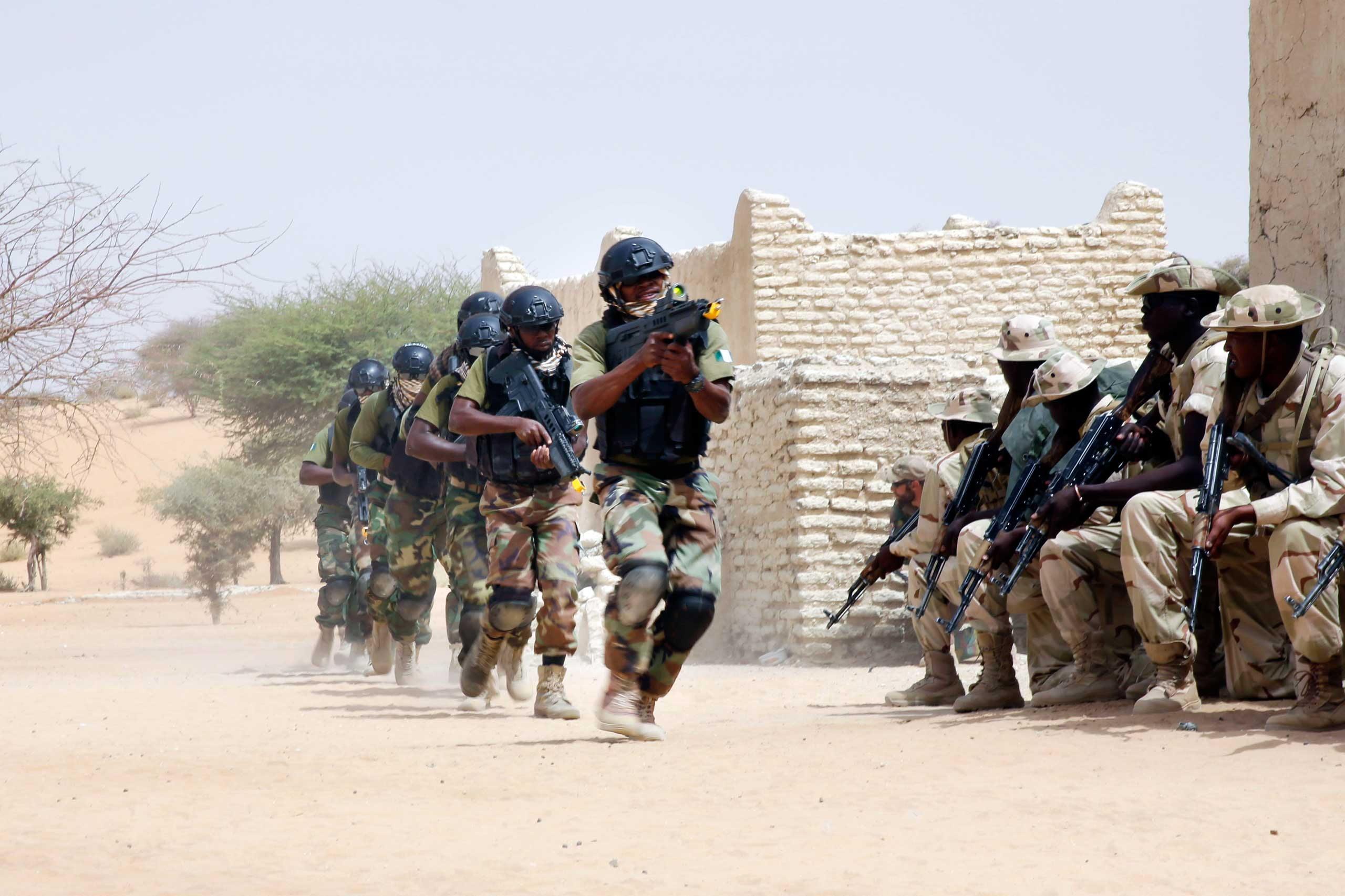Nigerian special forces run past Chadian troops in a hostage rescue exercise at the end of the Flintlock exercise in Mao, Chad on March 7, 2015.