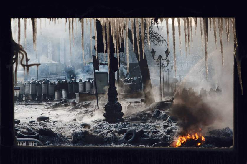 Jan. 25, 2014. Riot police keep a fire hose aimed at protesters continuously during rioting on Hrushevskoho Street in central Kiev. Freezing temperatures creates a dramatic landscape of fire and ice, Kiev, Ukraine
