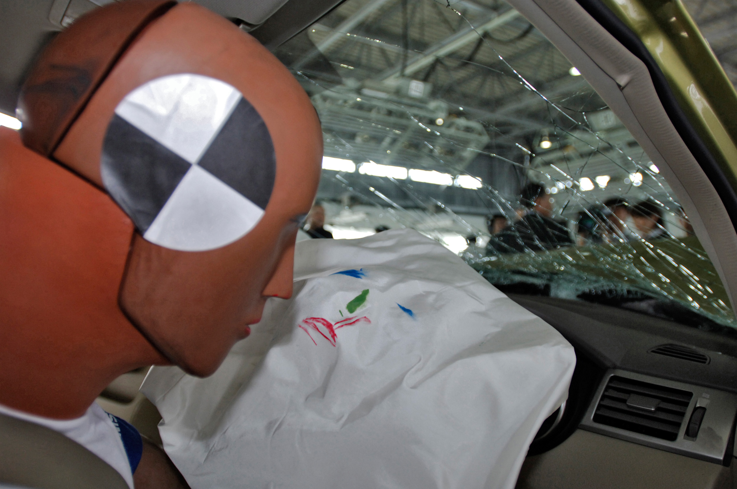 Colored marks indicate where a crash-test dummy's face struck an airbag in a Nissan Tiida sedan following a collision test at the Nissan Advanced Crash Laboratory in Yokosuka City, Japan, on Aug. 31, 2005