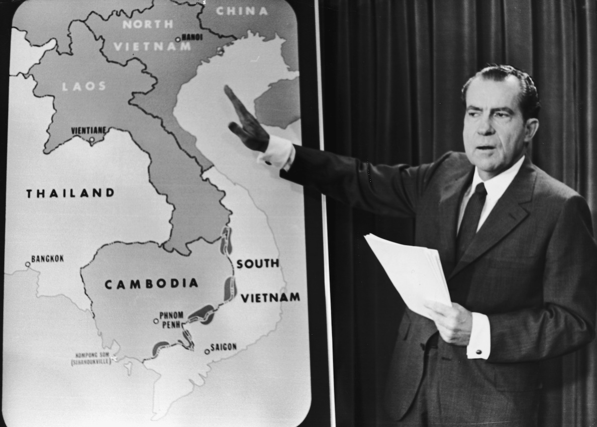Richard Nixon points to a map of Southeast Asia during a nationwide broadcast