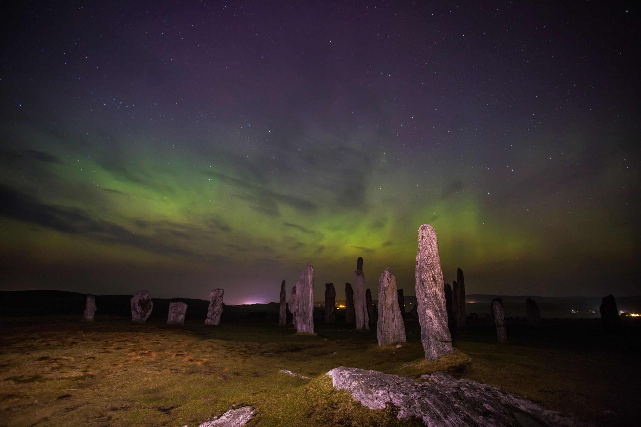 The Northern Lights over the Callanish Stones, Grimersta and Shawbost on Lewis and Harris hills on March 17, 2015.