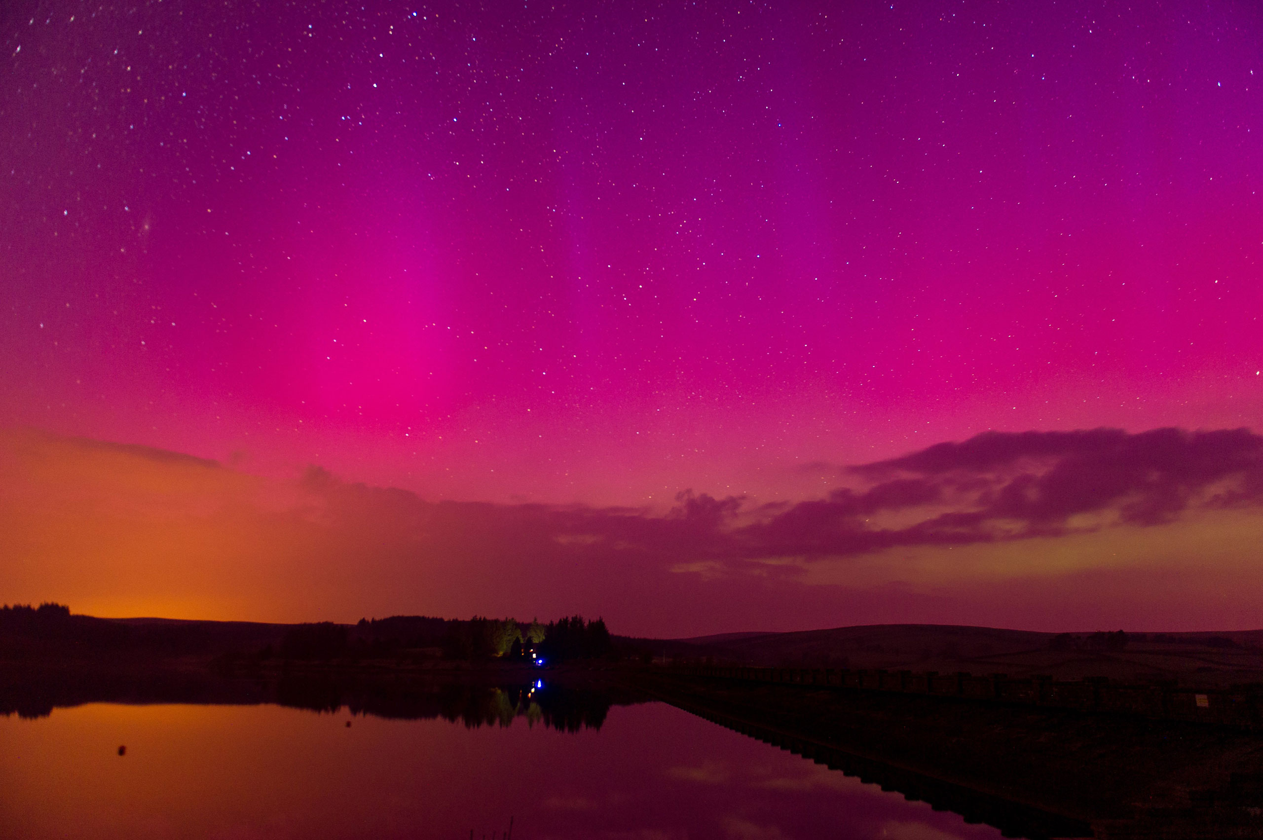 The Northern Lights are seen over Usk Reservoir at the Brecon Beacons, Wales, on March 17, 2015.