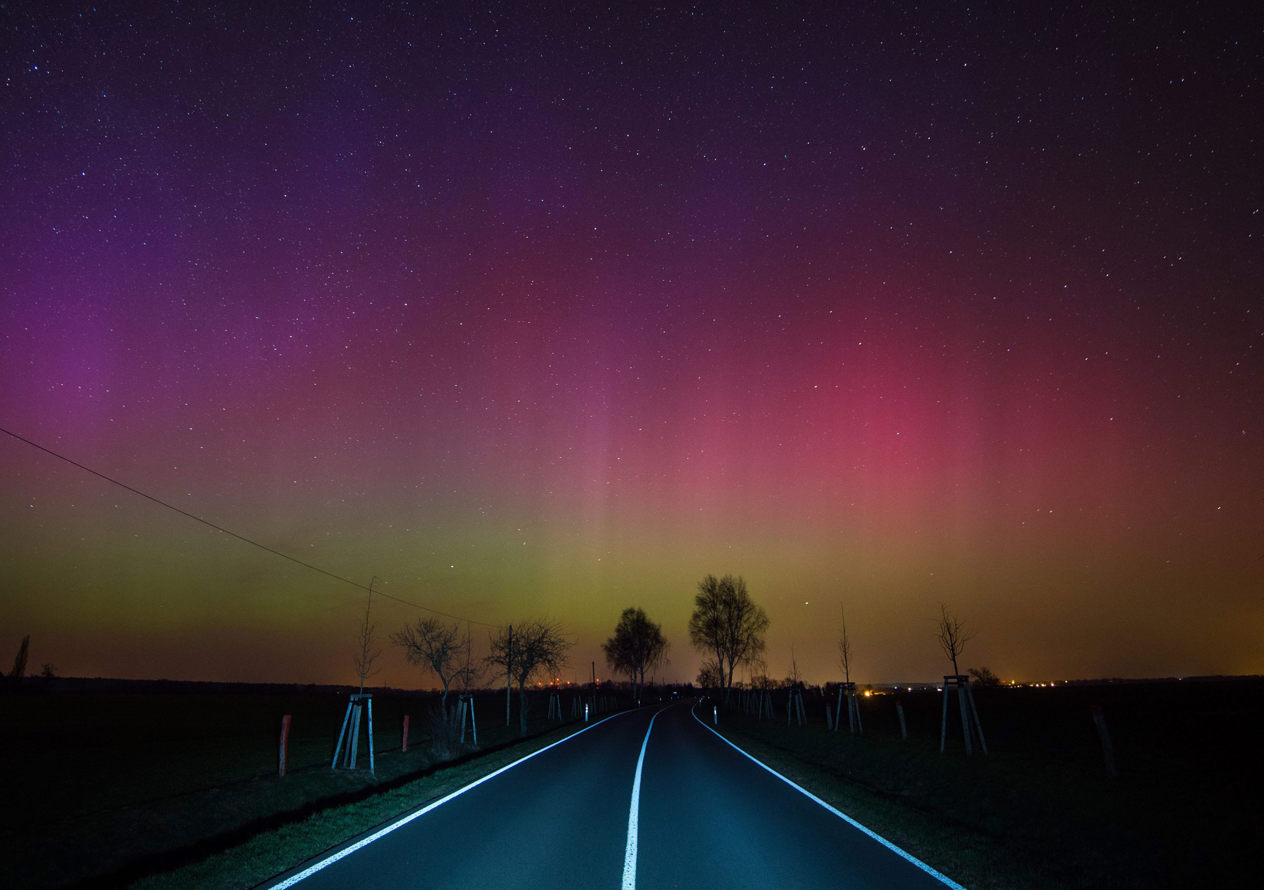 The Northern Lights over a country road near Lietzen in Maerkisch-Oderland, Germany, on March 17, 2015.