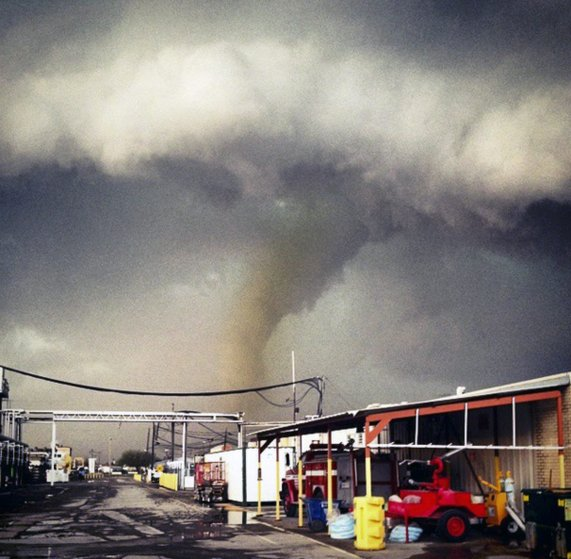 The funnel cloud of a tornado reaches down to the ground as a storm approaches Sand Springs, Okla. on March 25, 2015.