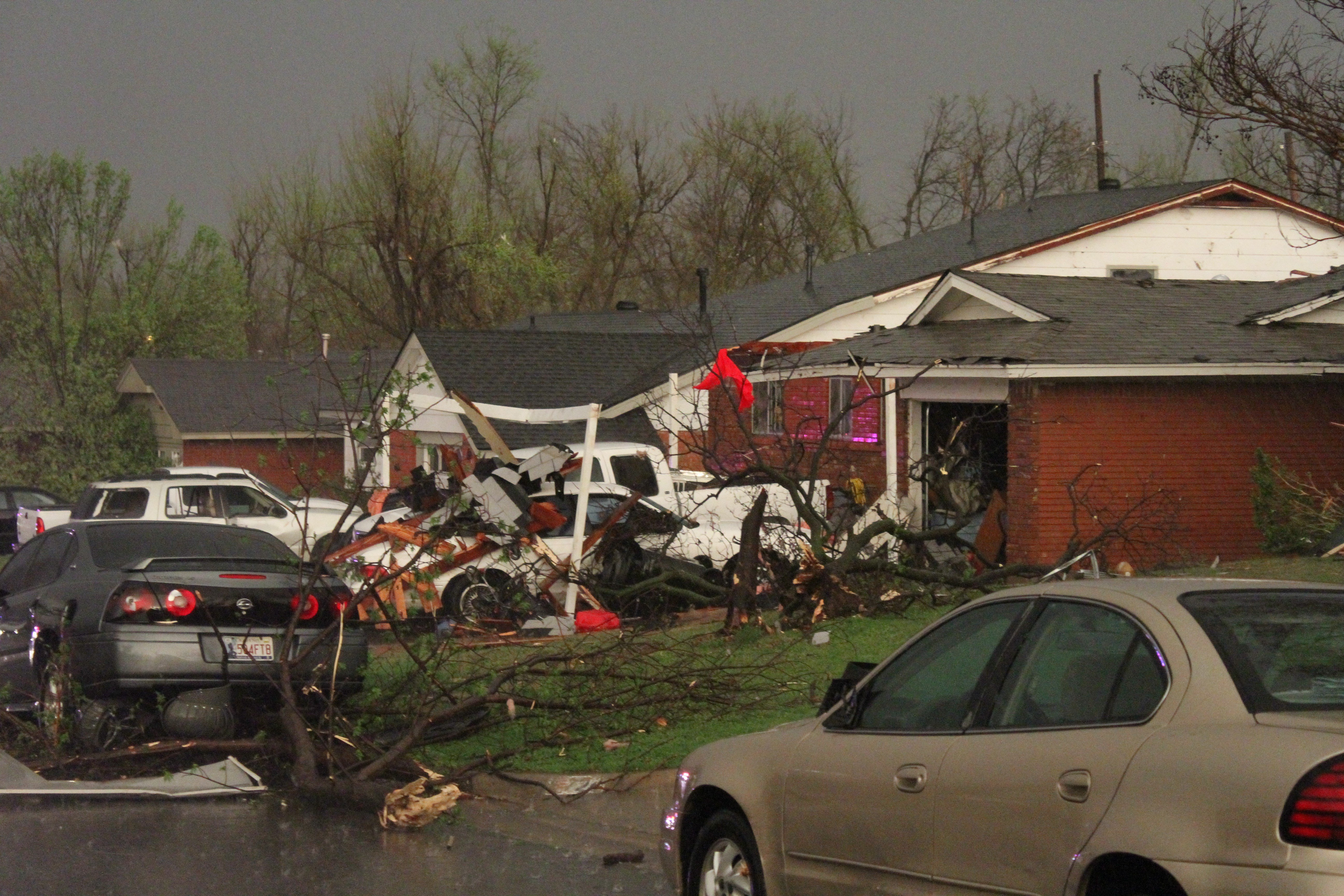 Cars, homes, downed trees and buildings damaged by a storm that spawned a tornado in Moore, Okla. on March 25, 2015.