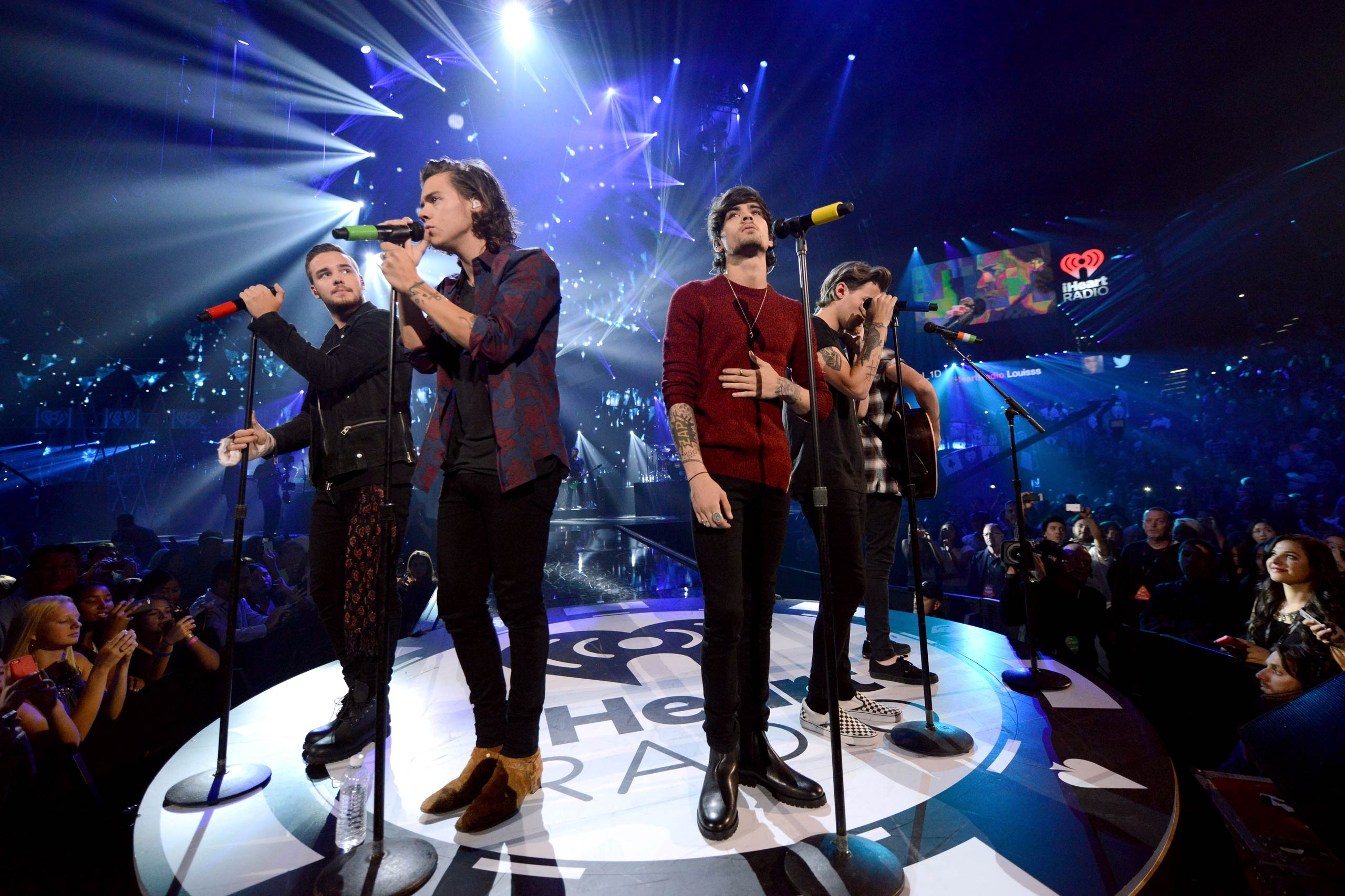 Liam Payne, Harry Styles, Zayn Malik, Louis Tomlinson and Niall Horan of One Direction perform onstage during the 2014 iHeartRadio Music Festival at the MGM Grand Garden Arena on Sept. 20, 2014 in Las Vegas, NV.